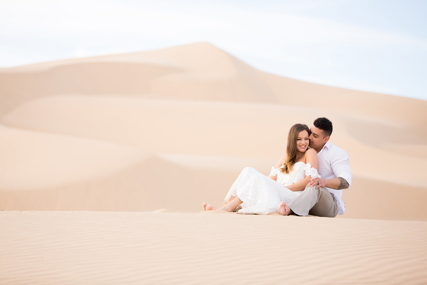 Couple Cuddling in Stunning Glamis Sand Dunes Photo