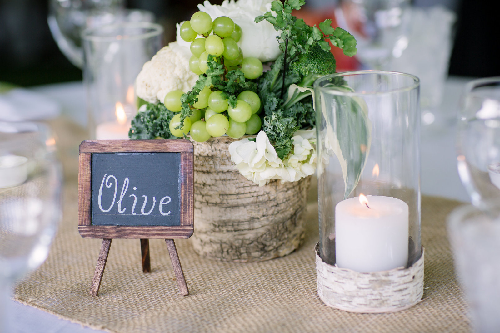Unique centerpiece with herbs and veggies and mini chalkboard