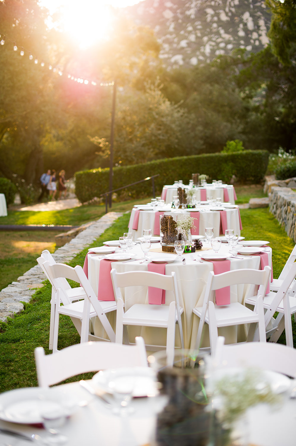 reception space with pink and white tables