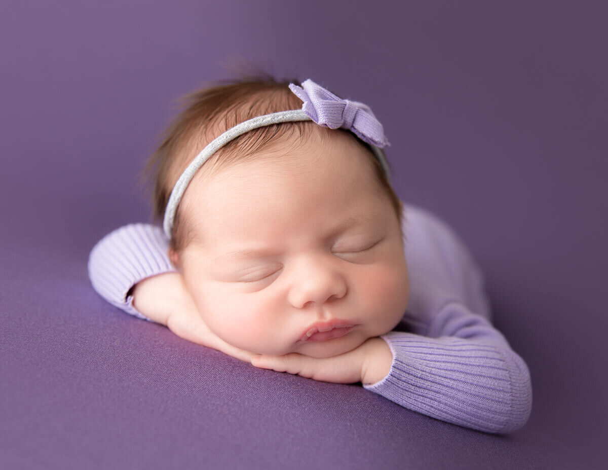 Little newborn posed at our Rochester, NY studio.