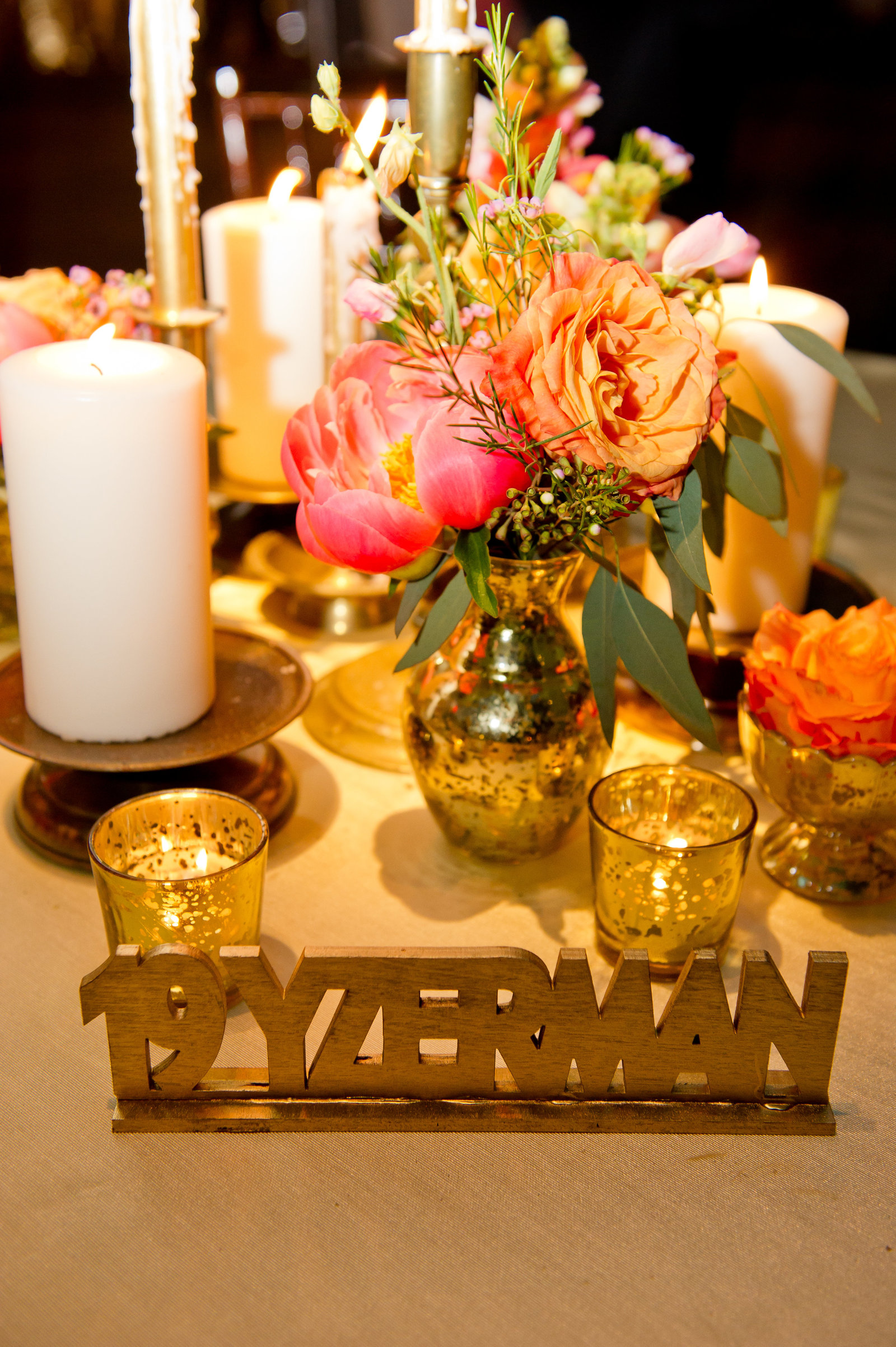 Custom event decor and table names by Ten23design with florals by A Garden Party for Jewish wedding ceremony and reception at Adventure Aquarium