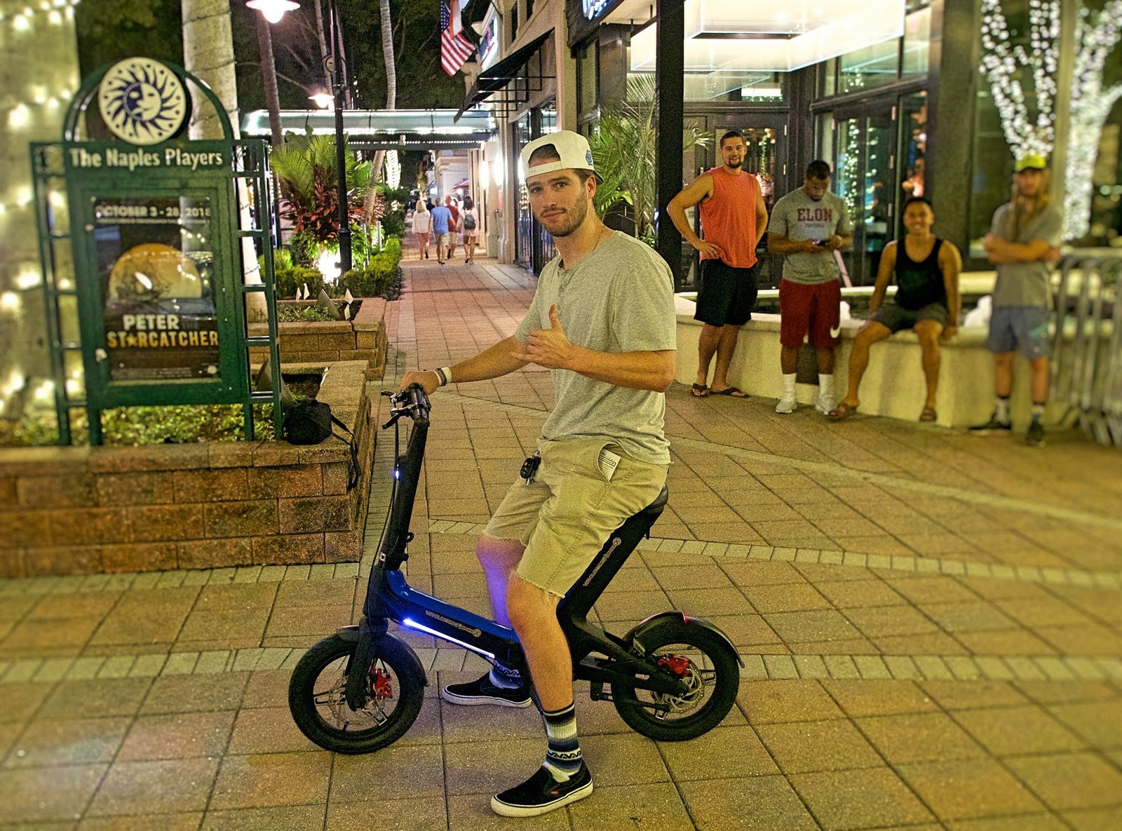 Sudent giving thumbs up to Blue Go-Bike M3