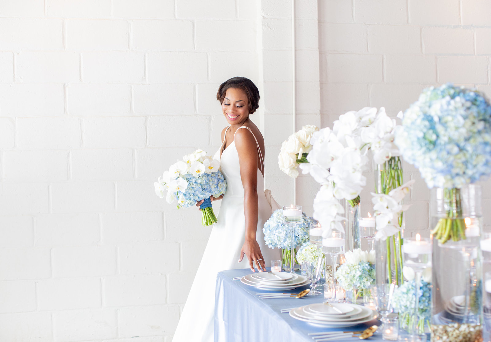 Elegant modern wedding with white and blue wedding decor