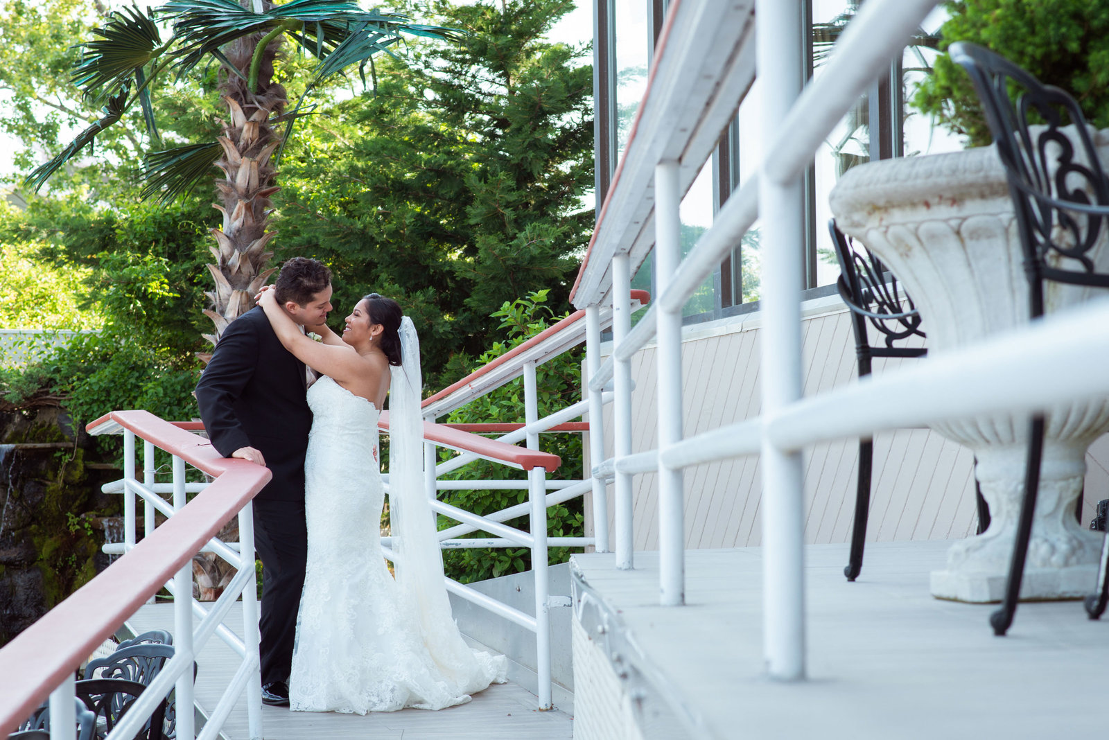 Bride and groom on ramp at Chateau La Mer