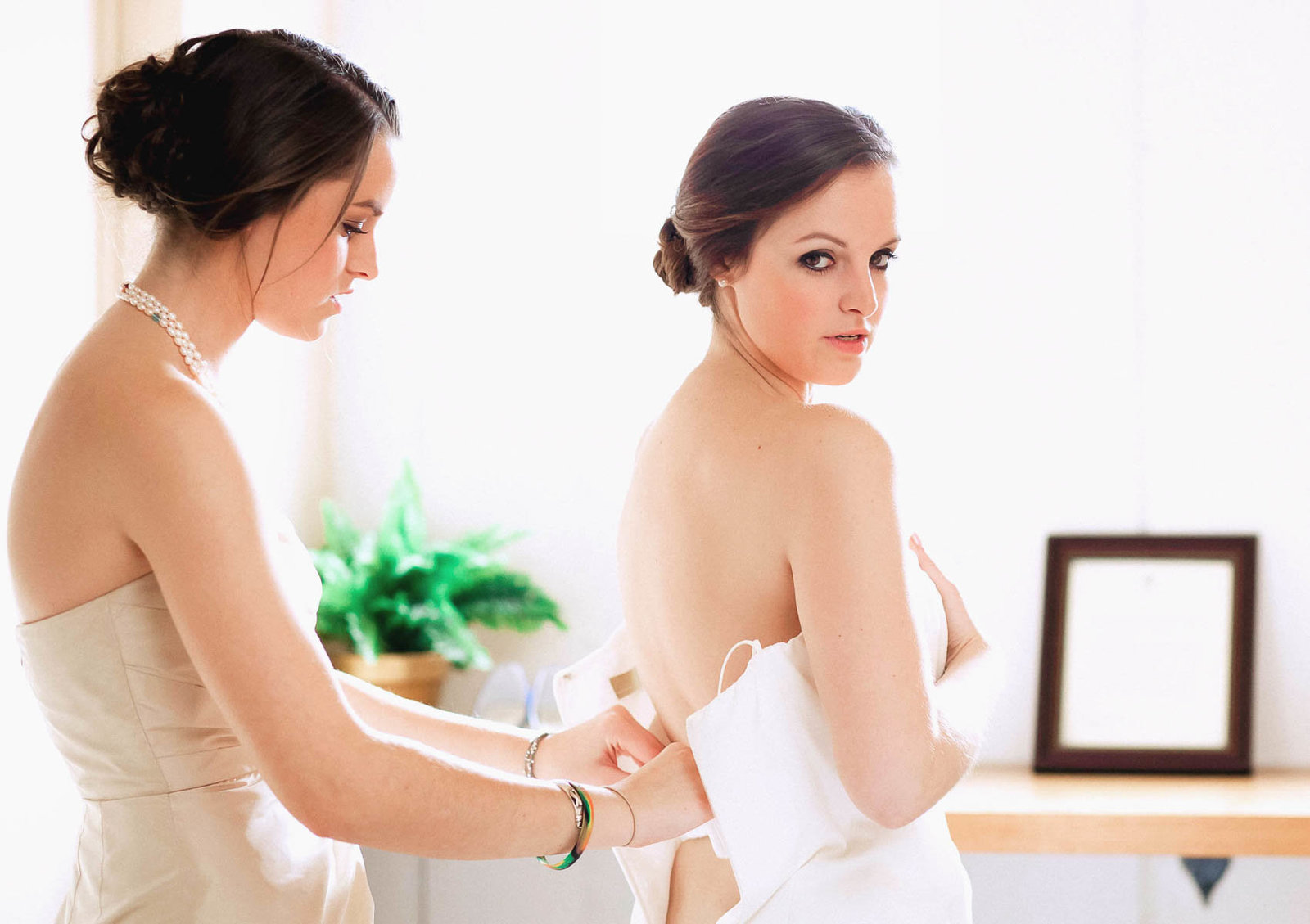 Bride gets into dress, Stonewall Golf Club, Elverson, Pennsylvania. Kate Timbers Photography.