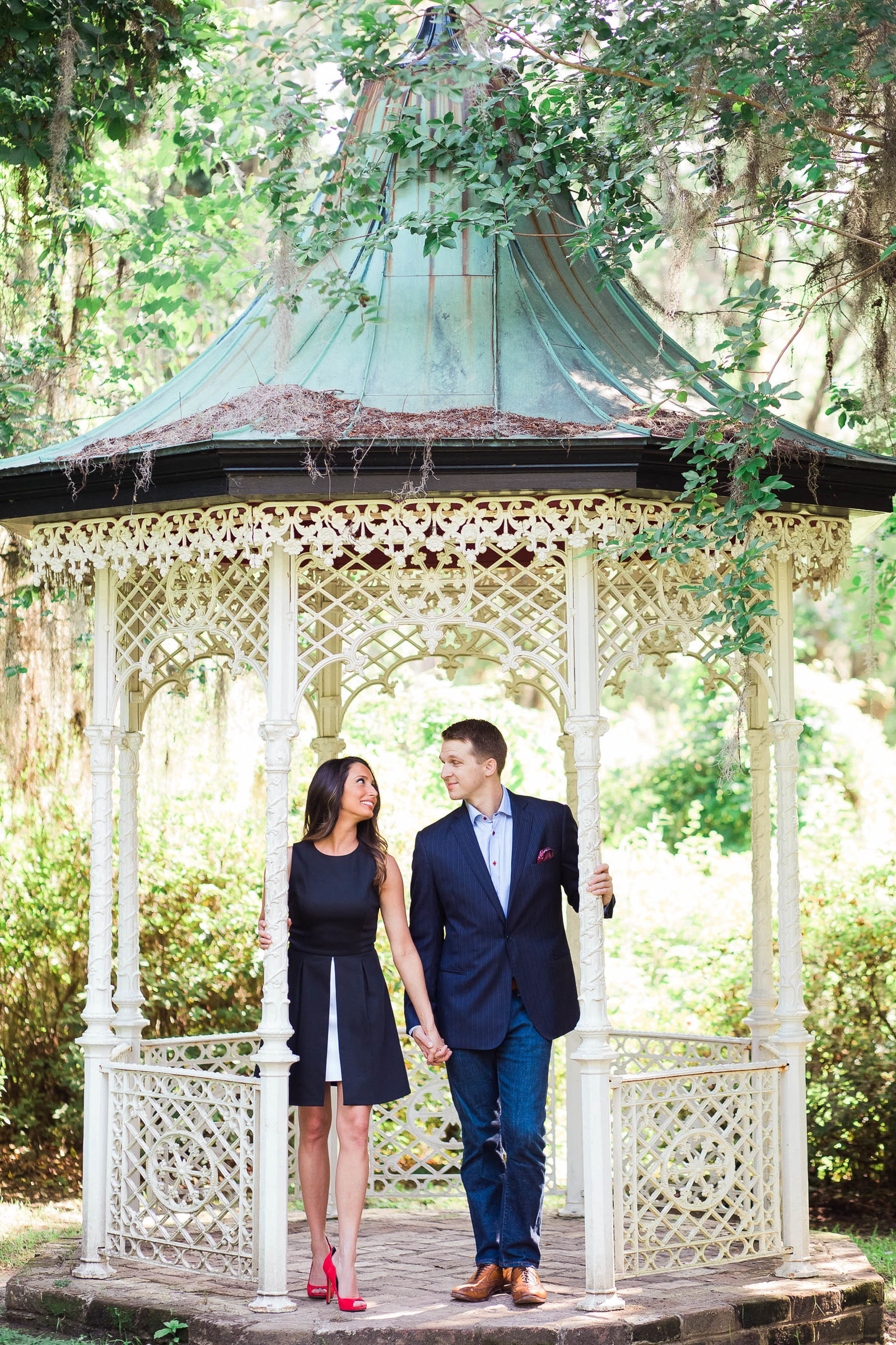 Engaged couple pose under antique gazebo, Magnolia Plantation, Charleston, South Carolina