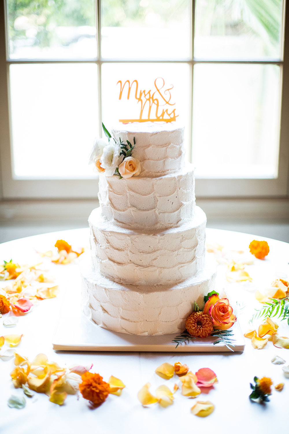 Bright flowers adorn this wedding cake