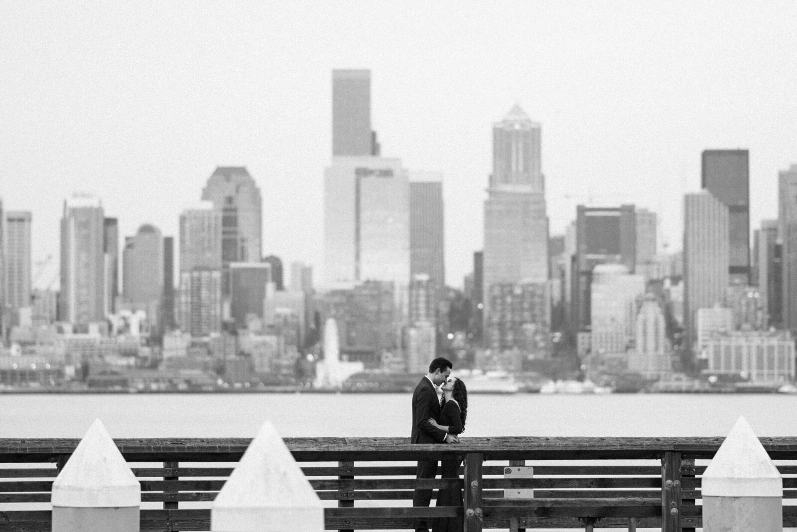 Engagement photos with Seattle skyline at sunset, near Seacrest Park and Alki Beach, the best spots for engagement photos in Seattle
