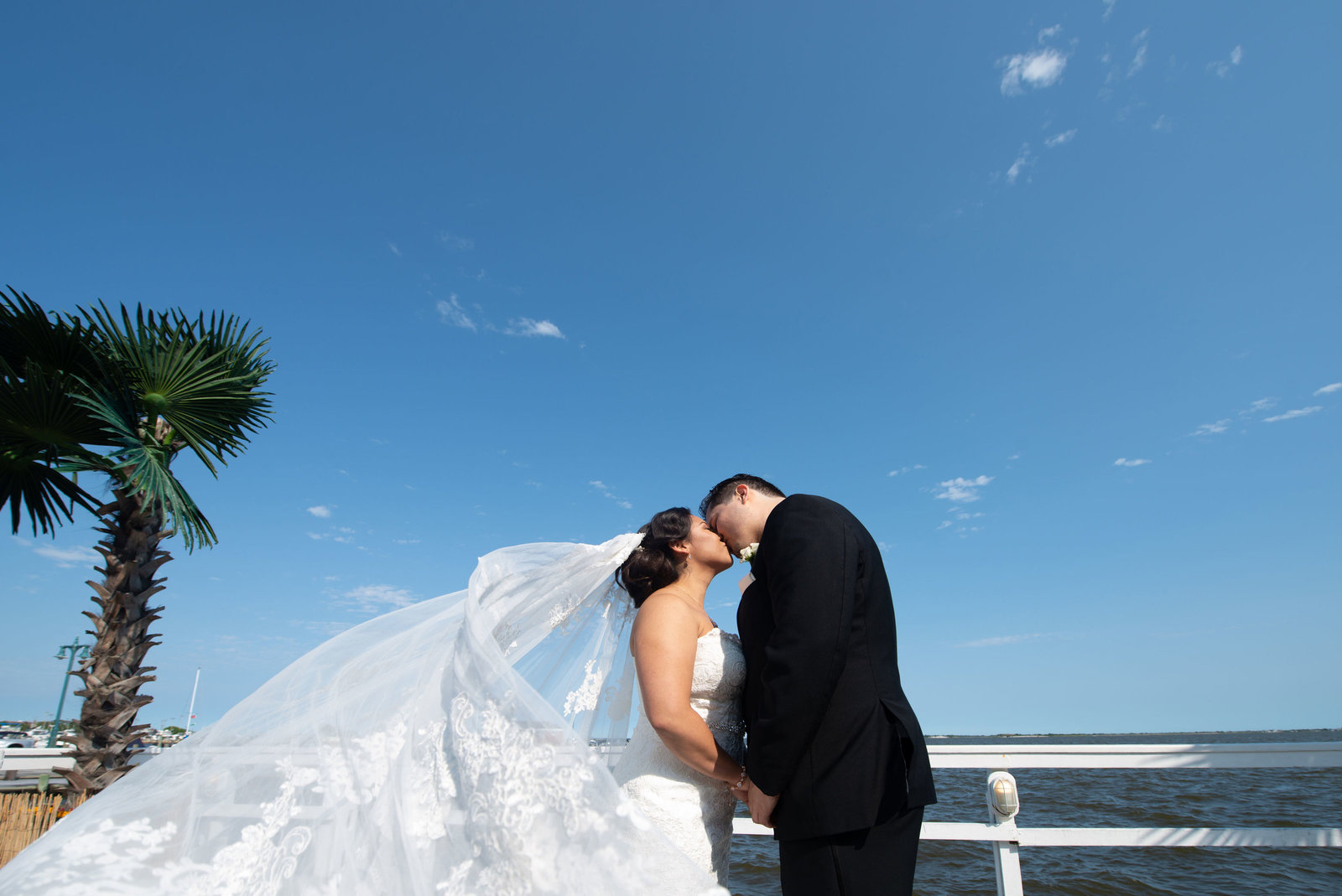 Bride and groom kissing at Chateau La Mer