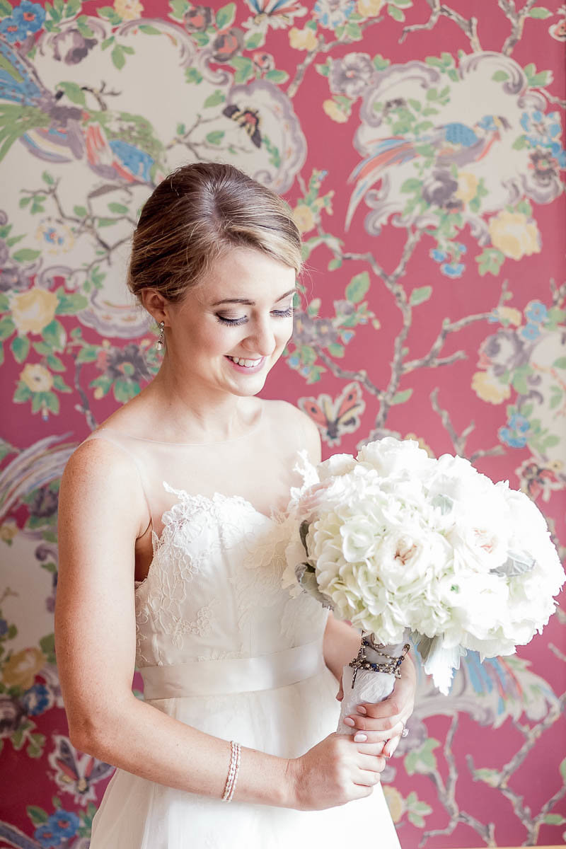 Bride stands in front of wallpaper, John Rutledge House Inn, Charleston, South Carolina