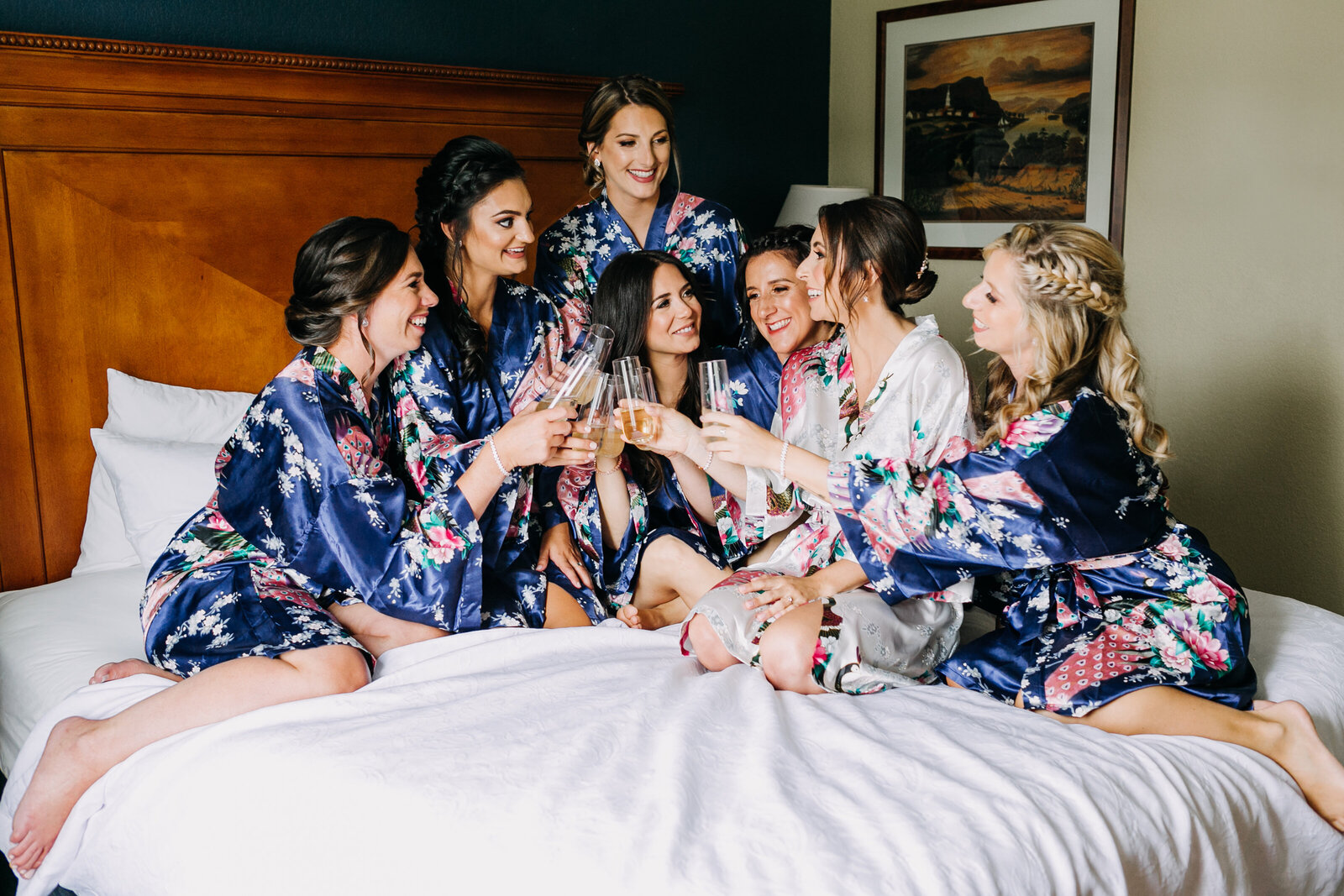 bride and bridesmaids cheering with champagne