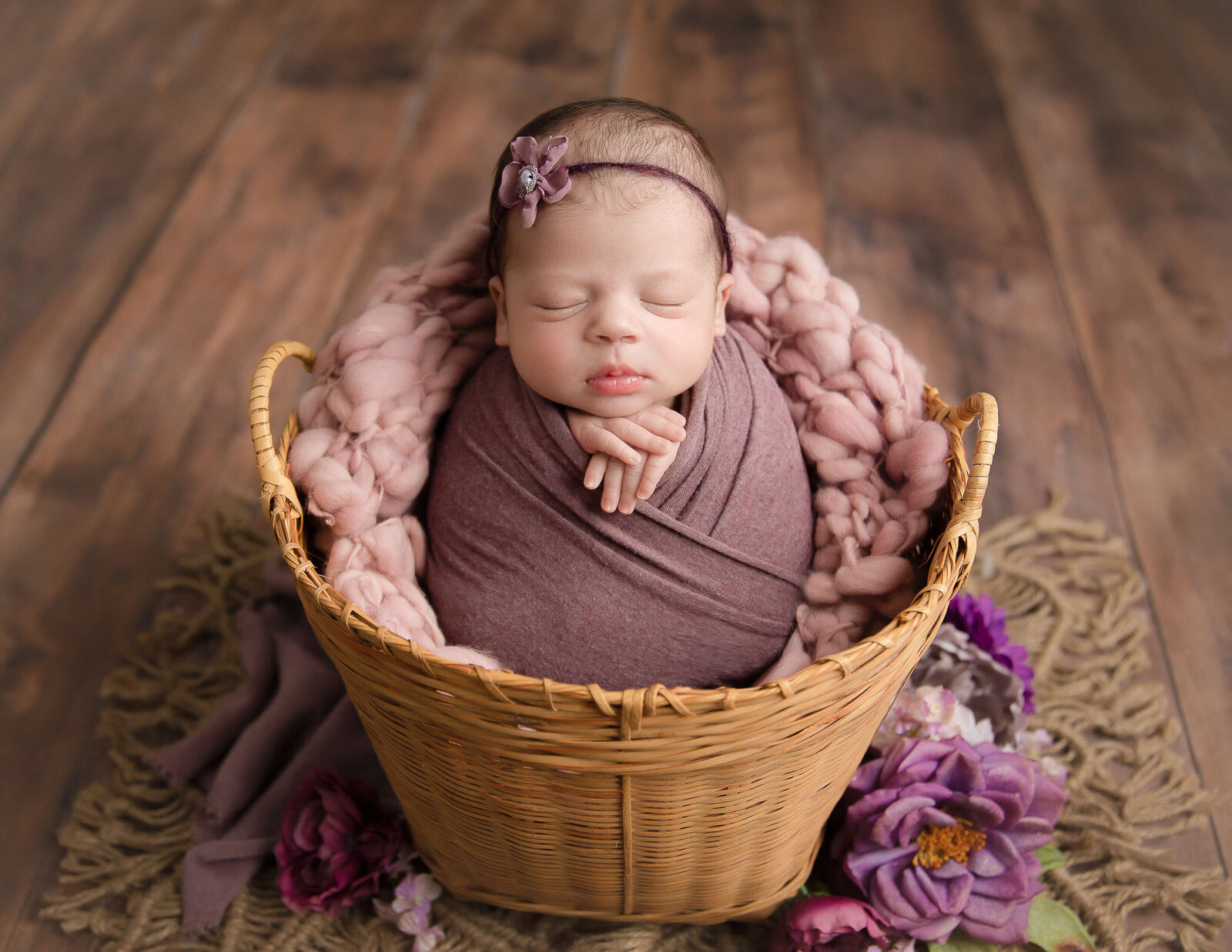 Sweet newborn girl posed at our Greece, NY studio.
