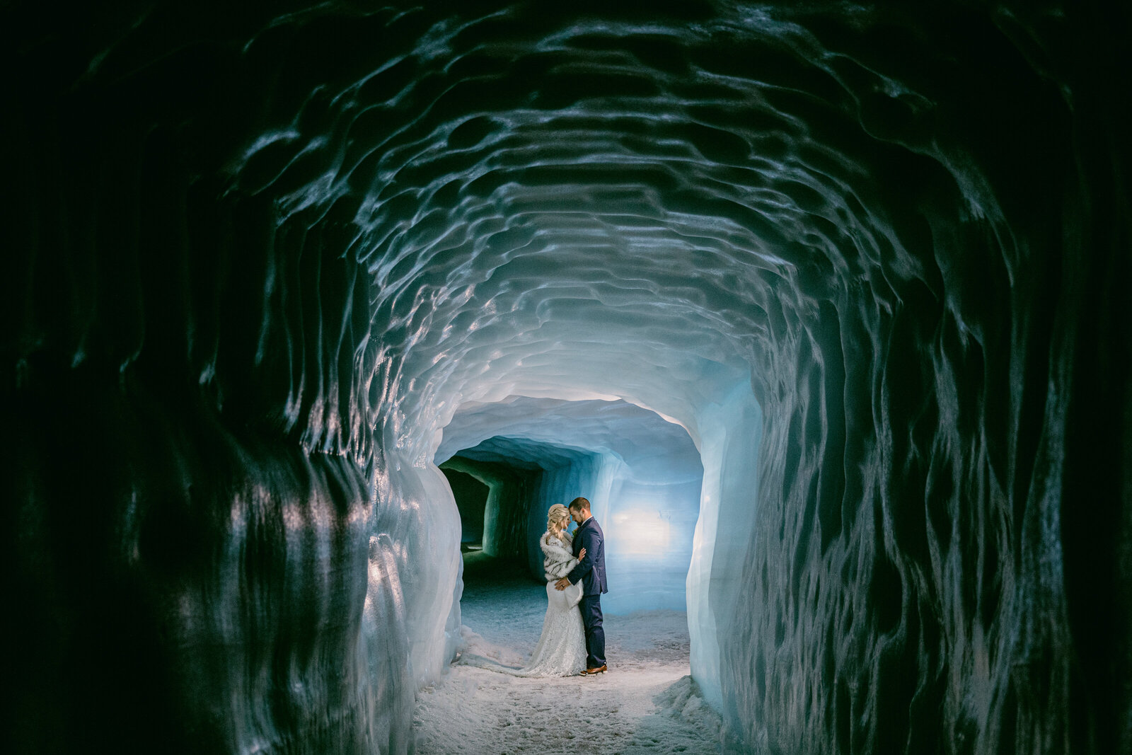 bride and groom in ice cave in iceland