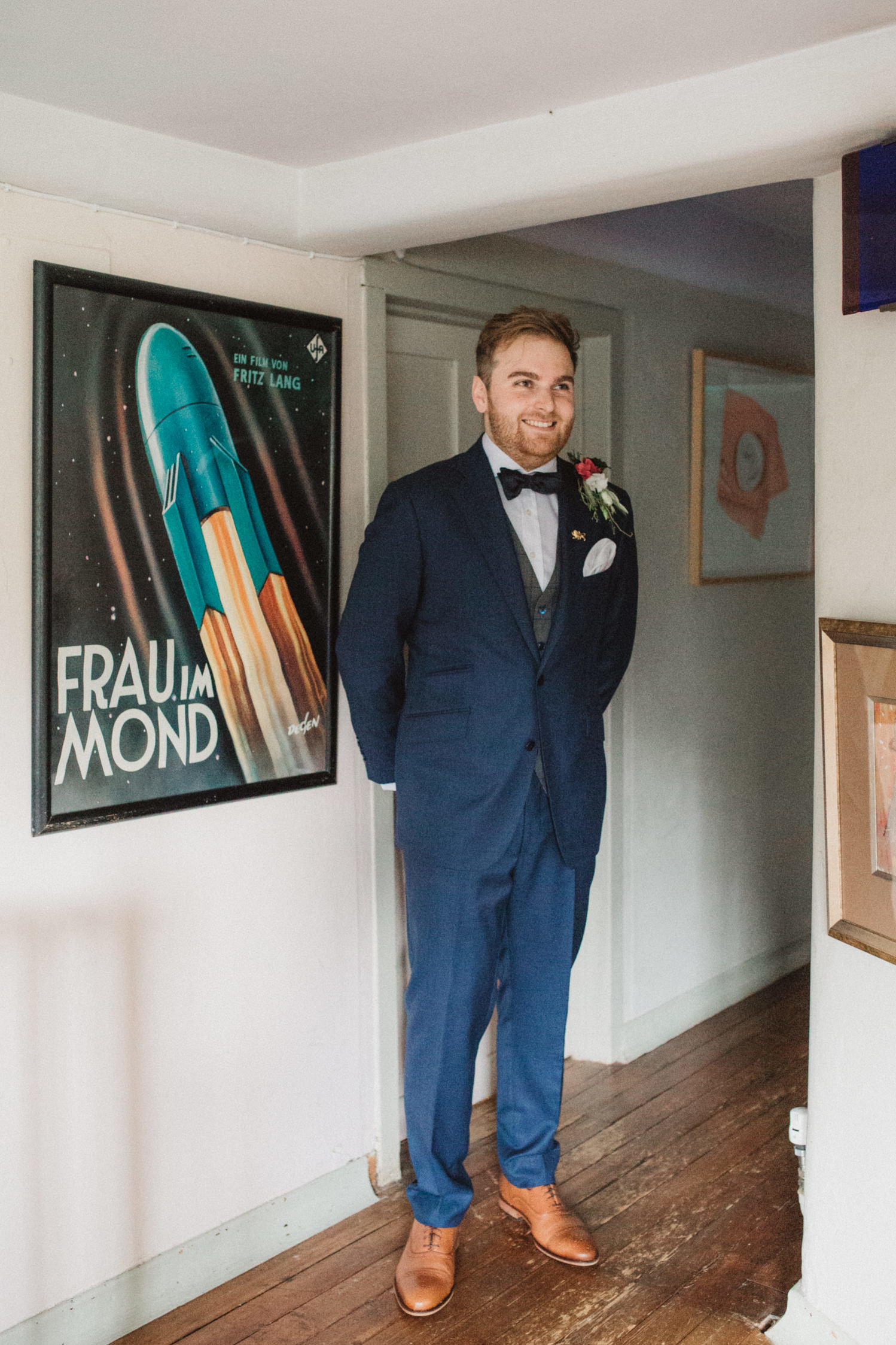 Relaxed smiling groom indoors after his wedding at Voewood, Norfolk