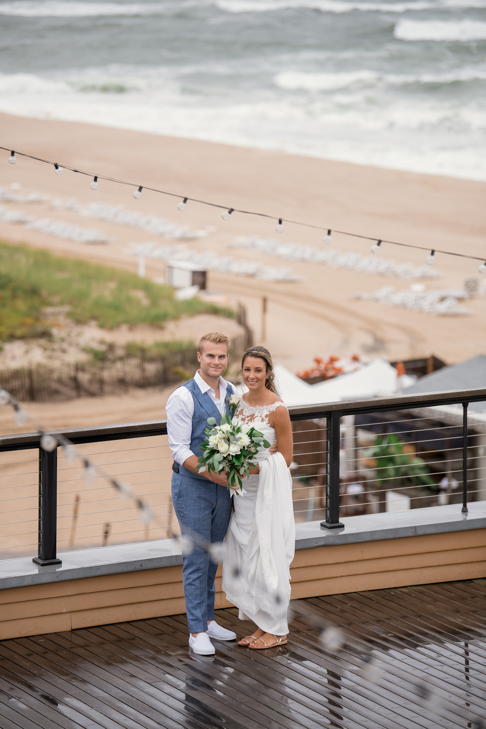 photo of bride and groom smiling on the outside deck at Gurneys Montauk Resort wedding