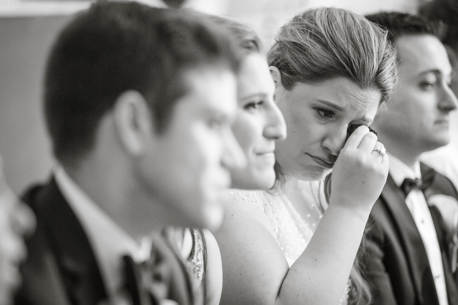mother of the bride crying during ceremony at Engineers Country Club