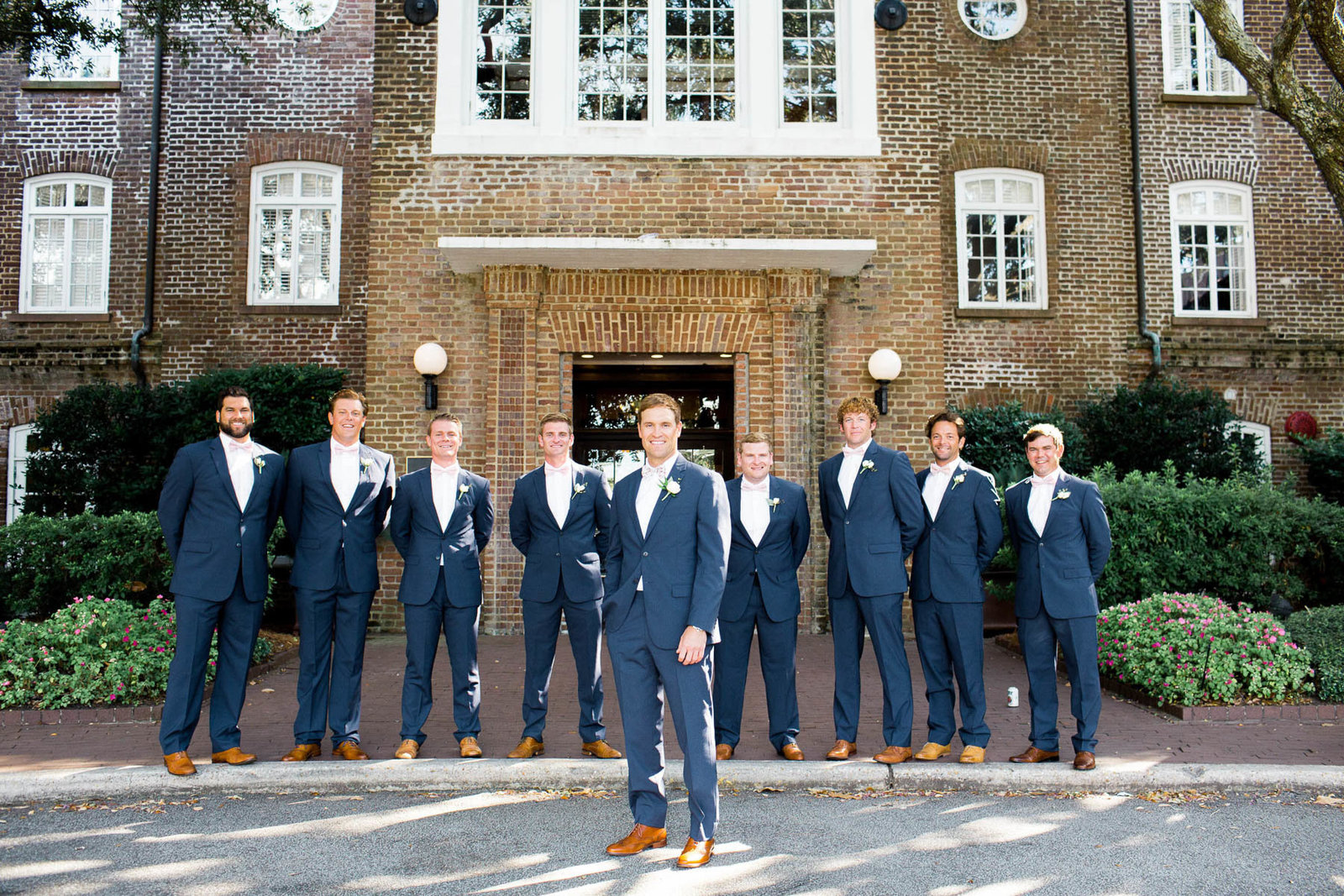 Groomsmen line up in front of the Rice Mill Building, Charleston, South Carolina
