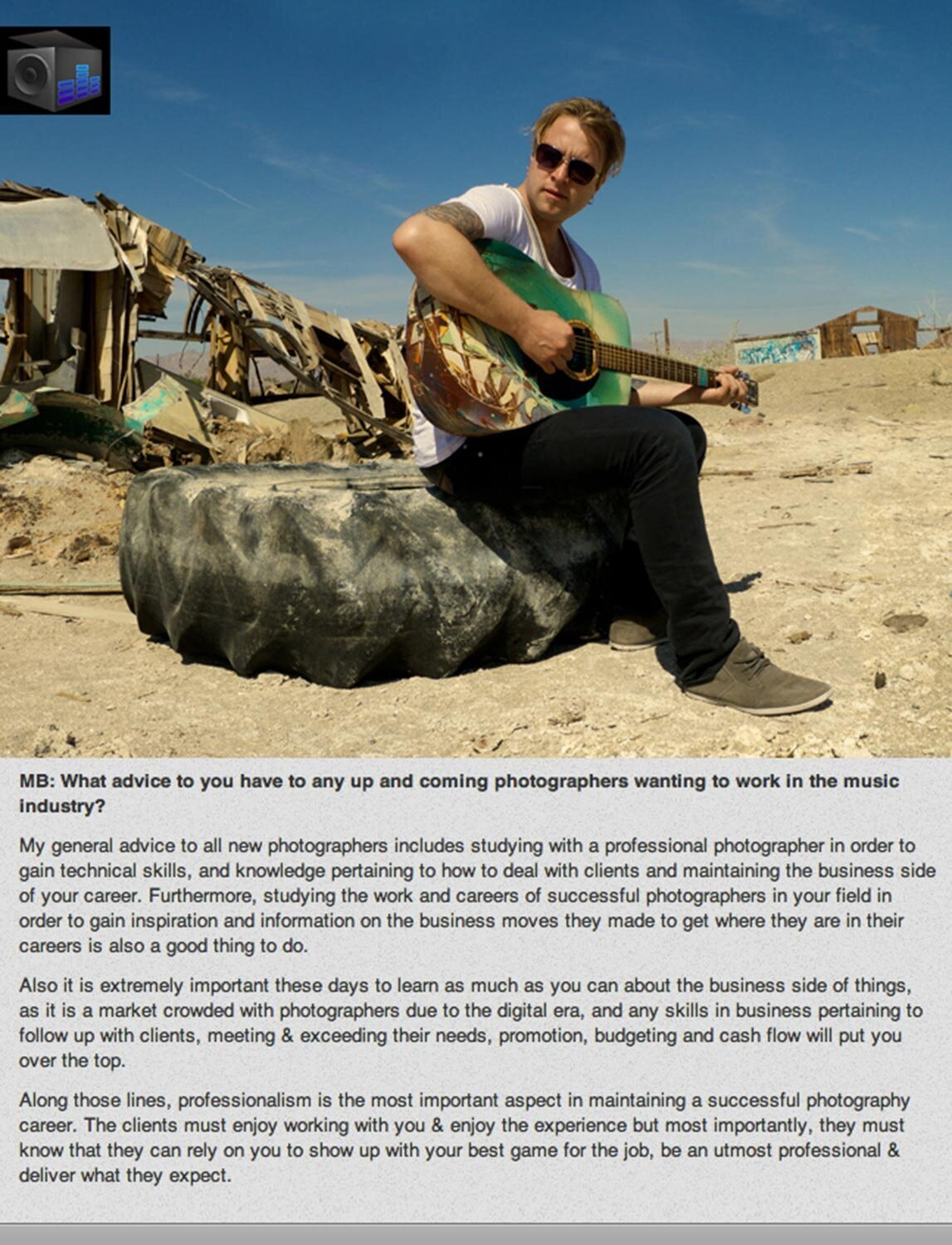 Interview with Los Angeles Photographer Mark Maryanovich page 3 photo of musician sitting on large rock in desert strumming guitar Publication Musicbox Artist Consulting