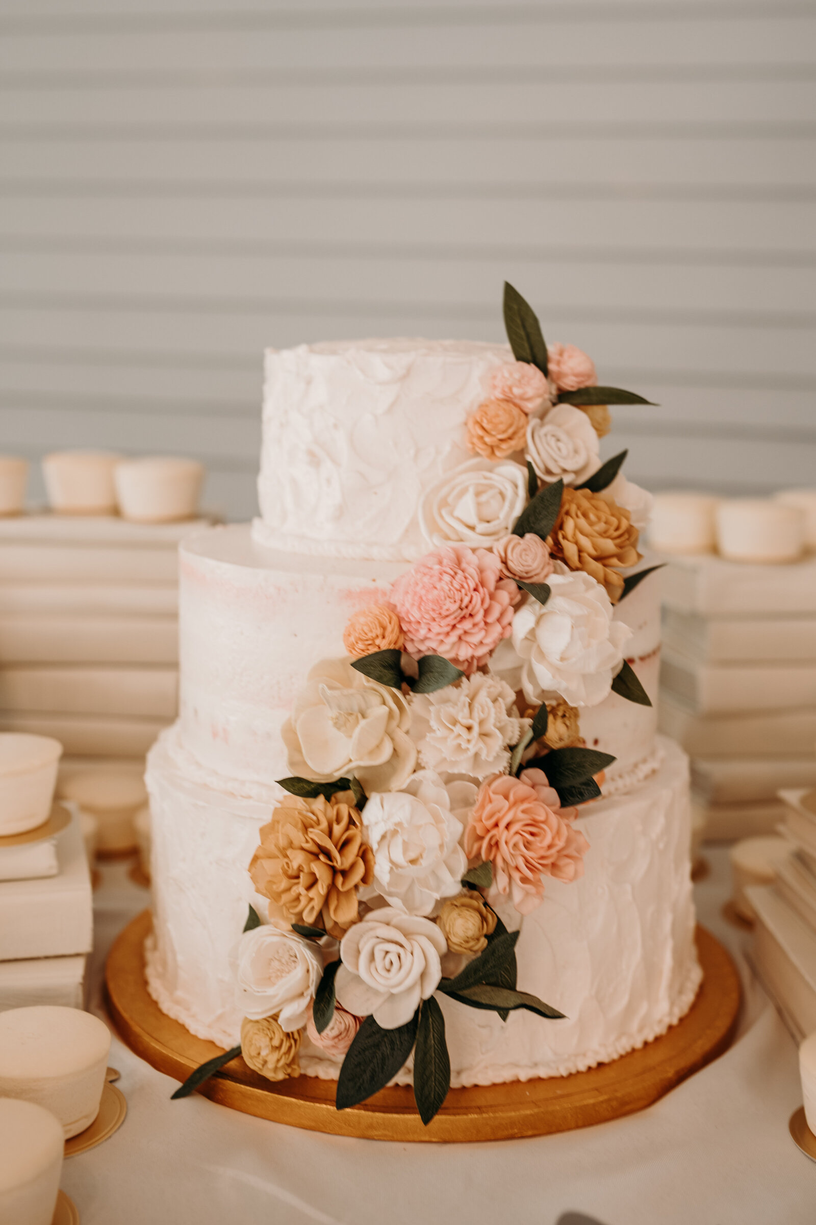 J.Michelle Photography photographs a floral wedding cake at Athens, Ga Wedding