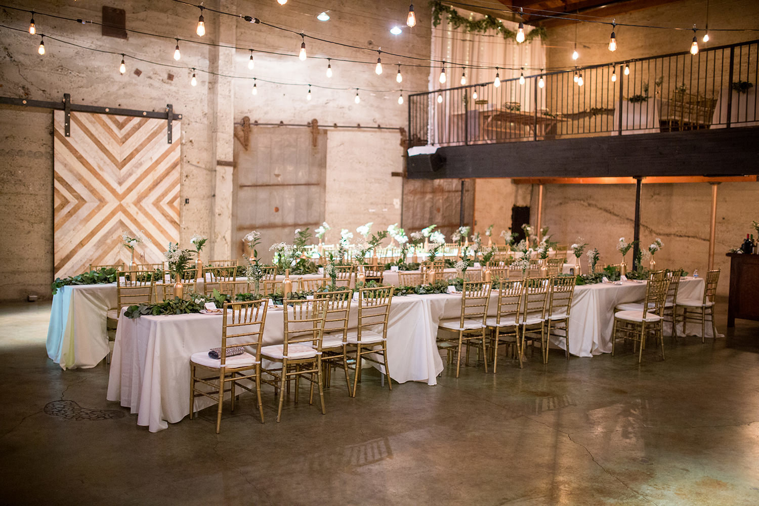 reception space at luce loft with lights and flowers