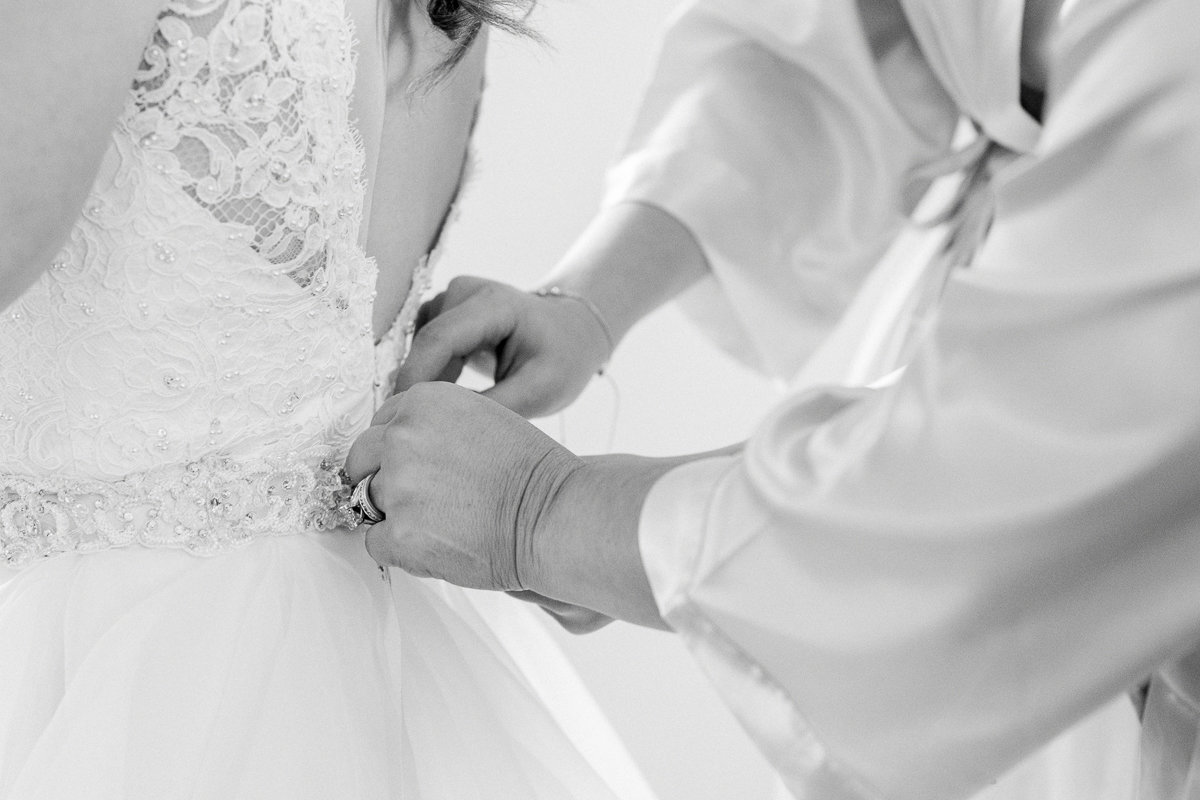 Covington Farm Wedding Photographer | Covington Farm Wedding Venue | Bride getting into dress-14