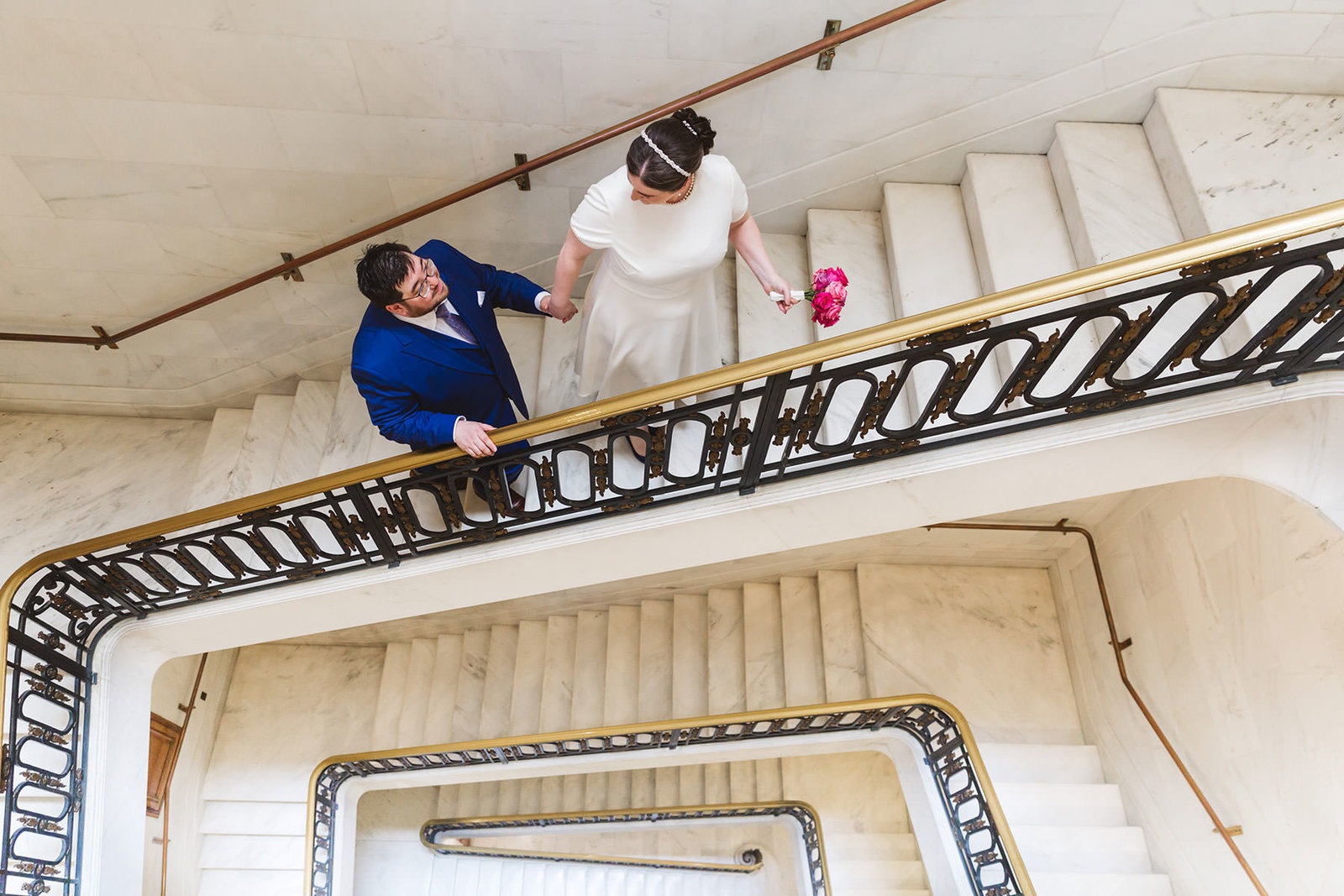 eloping couple on the staircase