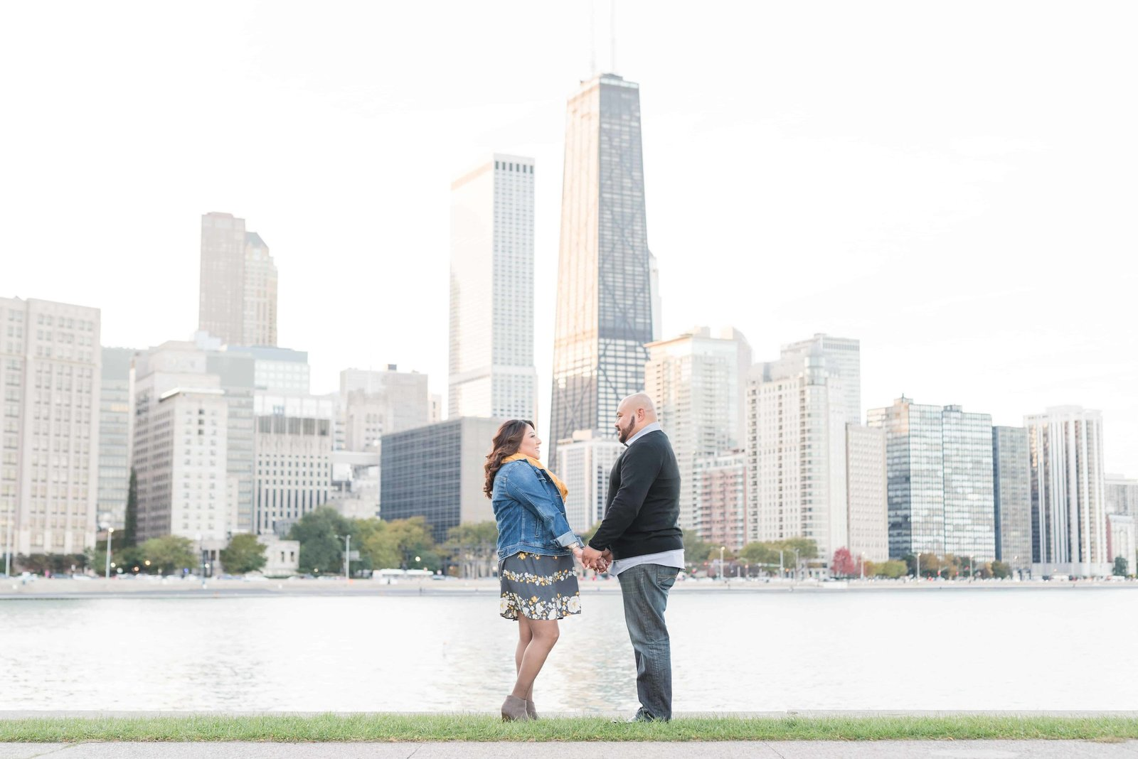 Engaged couple holding hands overlooking downtown Chicago