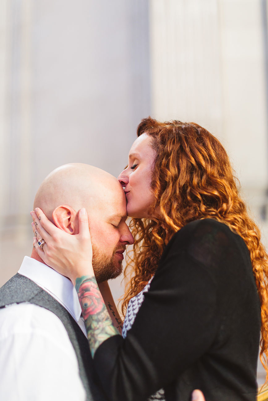 couple kissing tenderly at San Francisco City Hall by Zoe Larkin Photography