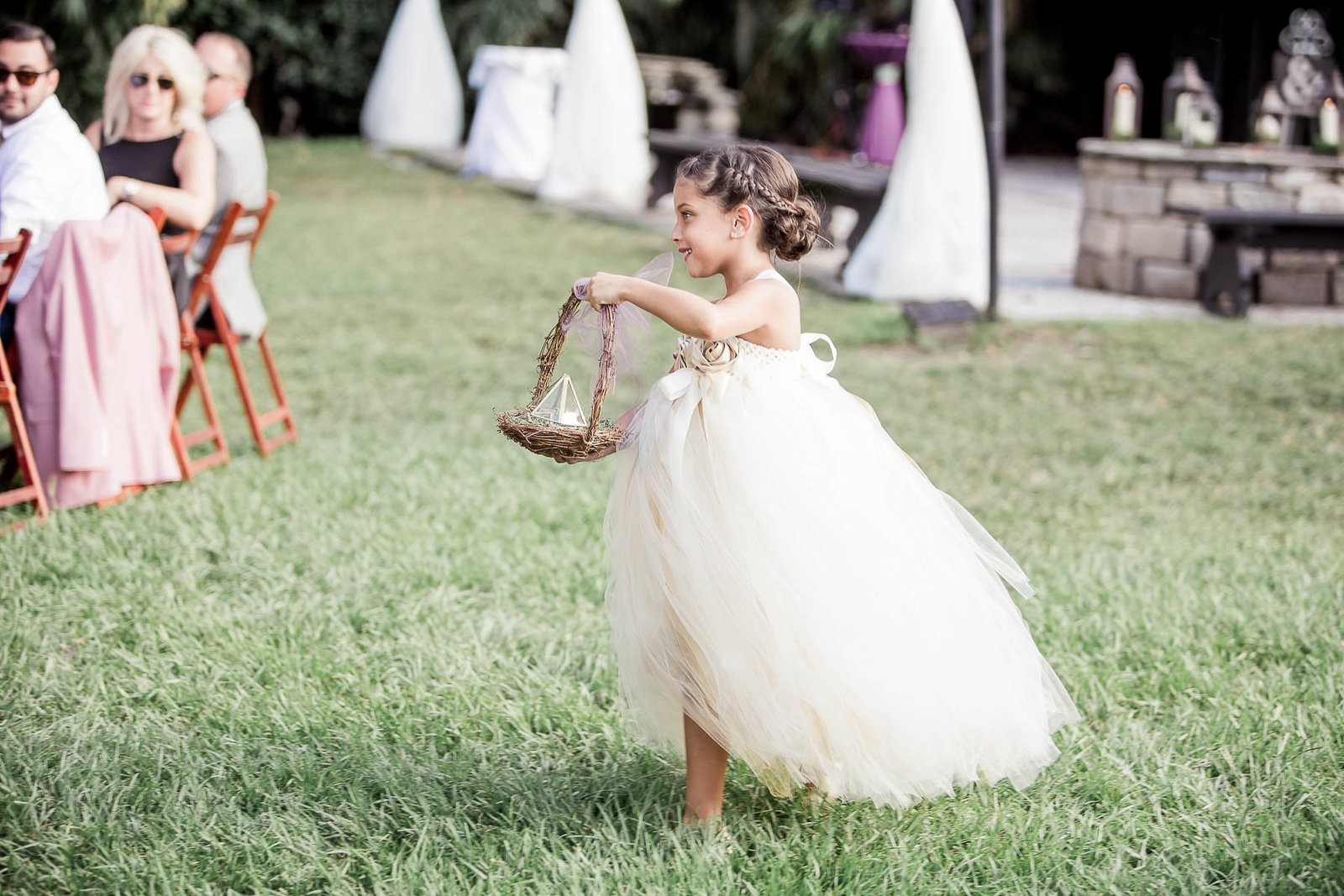 Flower girl walks up the aisle, Magnolia Plantation, Charleston, South Carolina
