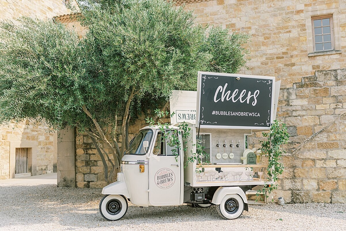 Mobile Wedding Bar decorated with green and white florals