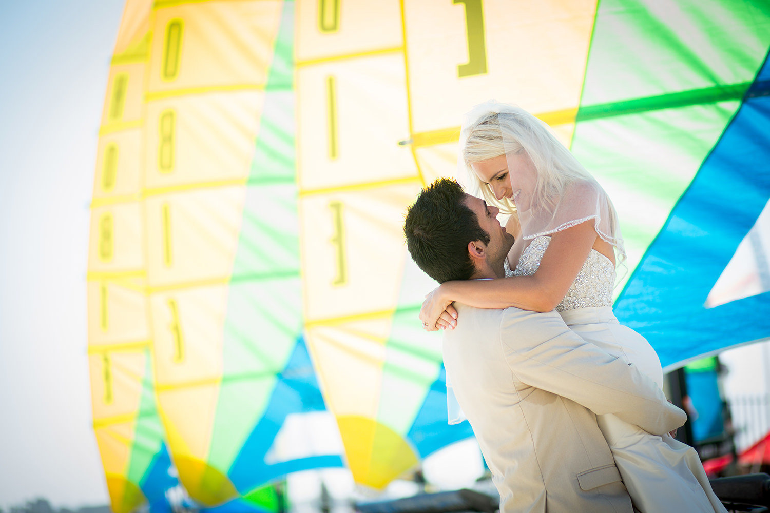sail boats with blues and yellows bride and groom