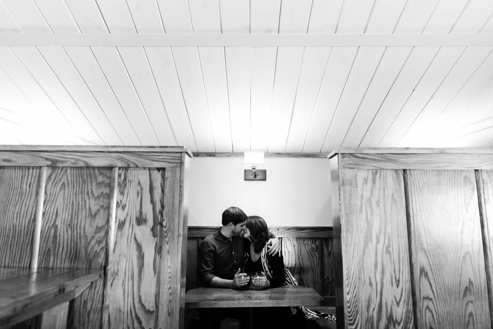 Black and white engagement photo at Civil Life Brewery in St. Louis