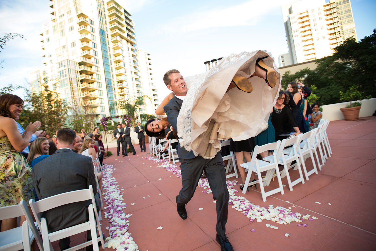 groom carries bride down the aisle funny