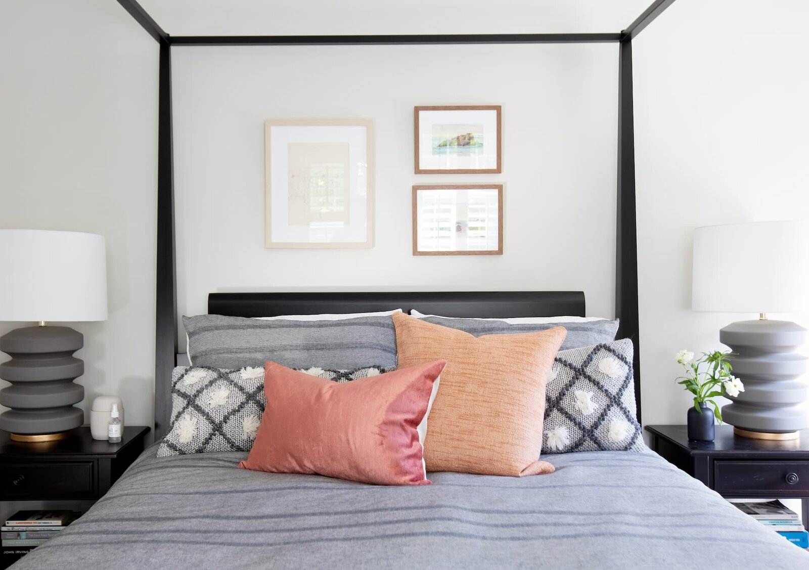 Granville Street l Canopy Bed with Peachy Tone Pillows and Mini Gallery Wall above Bed
