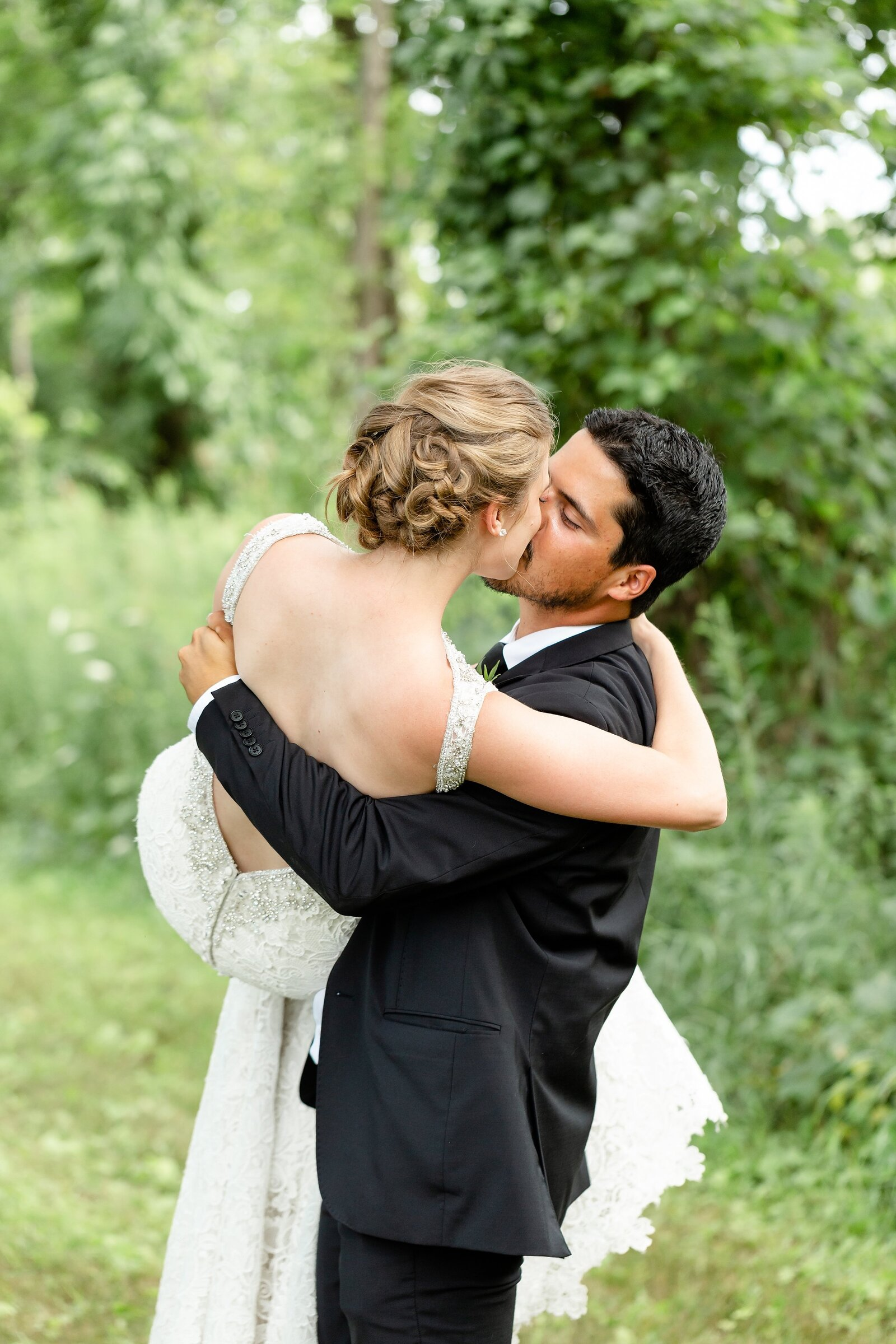 Groom-picks-up-his-bride-and-kisses-her