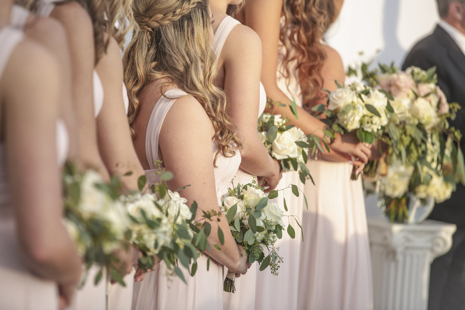 close up of bridesmaids flowers during wedding ceremony in Granbury Texas
