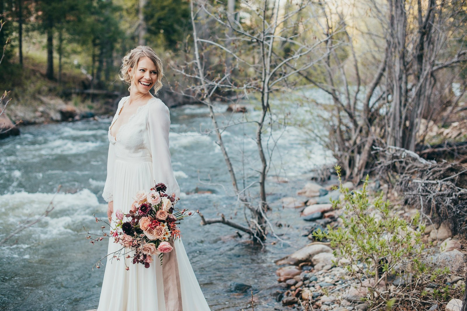 A bride by the Pecos River at Brush Creek Ranch in New Mexico