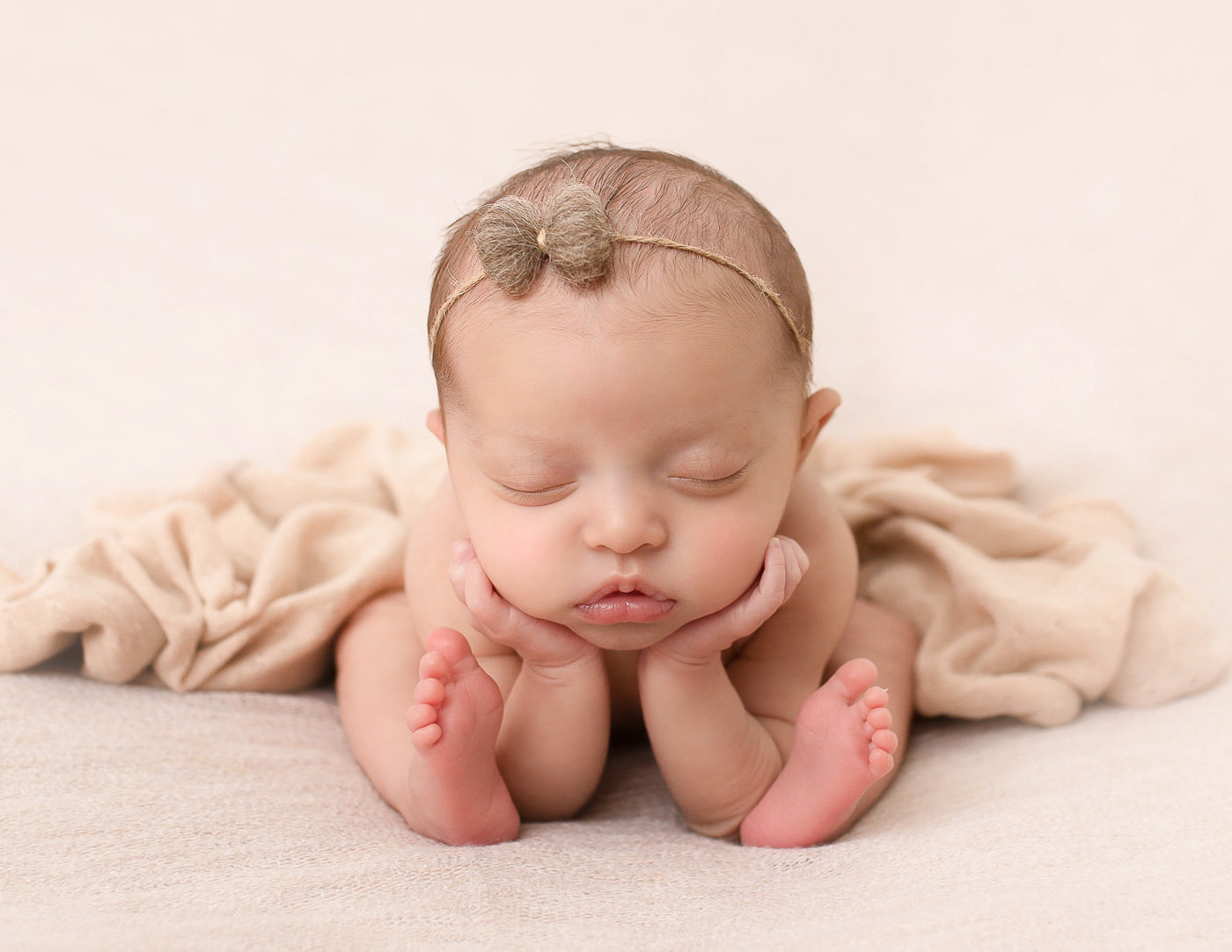 Posed newborn at our studio in Rochester, NY.