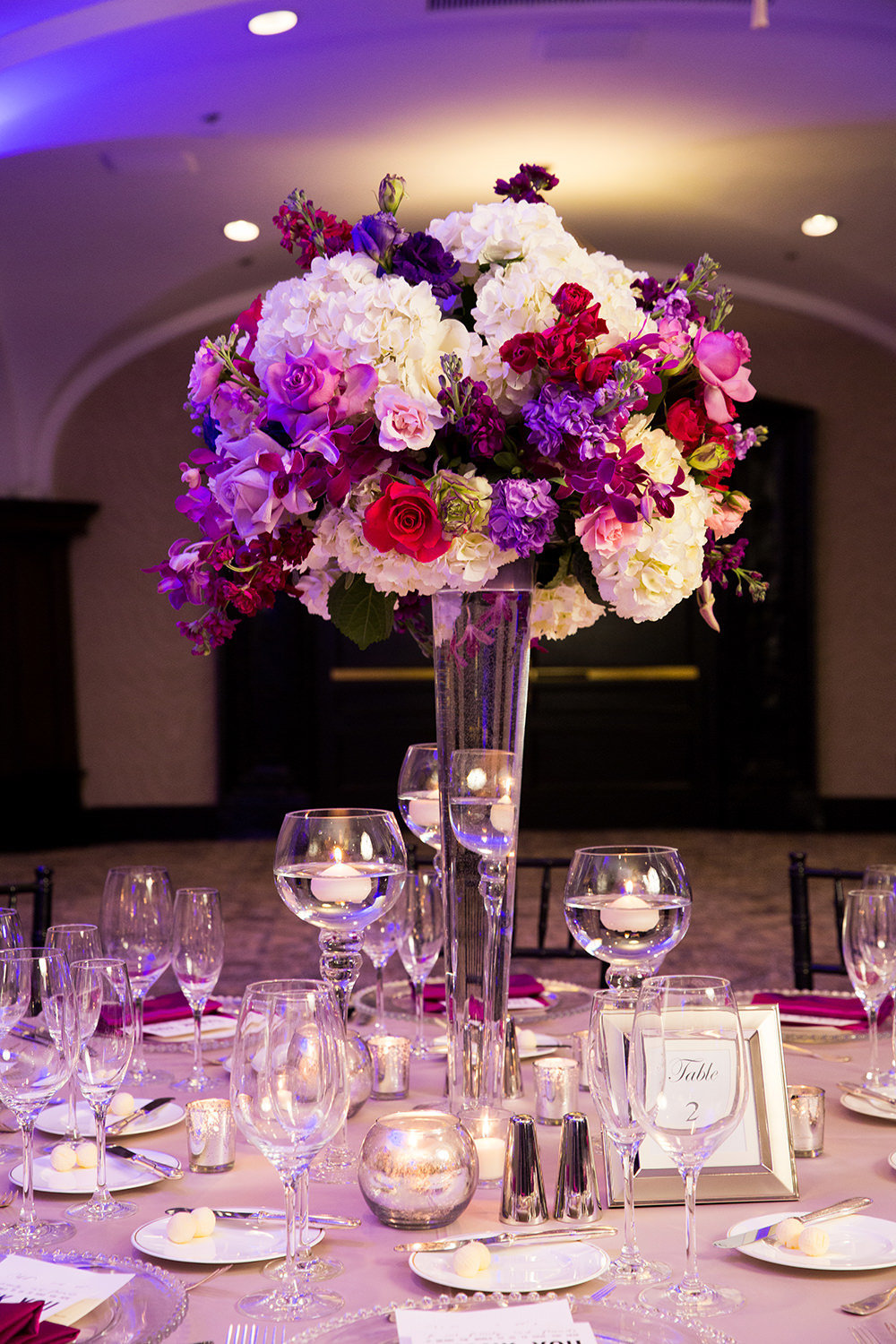 table arrangement with purples and pink flowers us grant hotel