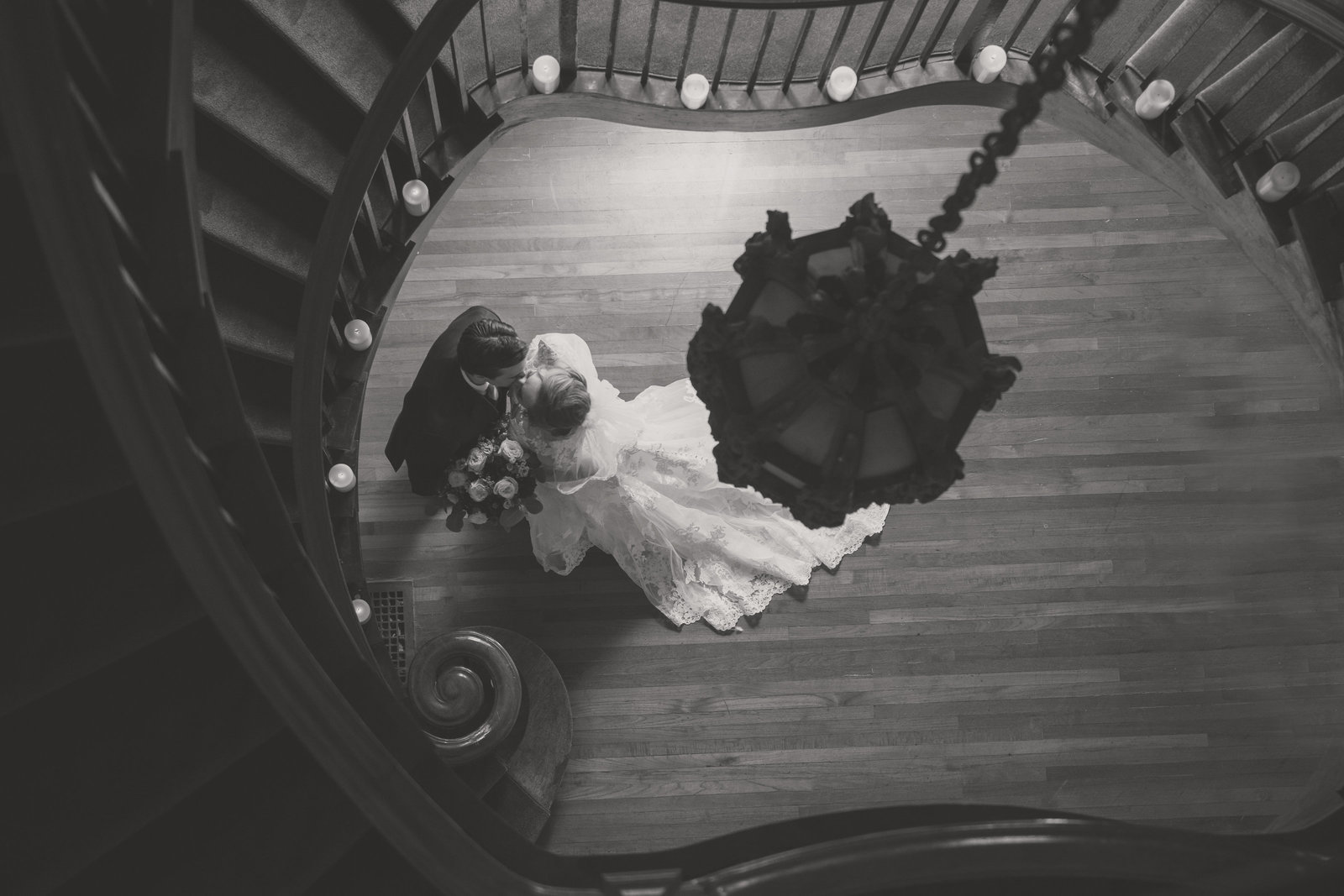bride and groom black and white photo from top of stairs at Coindre Hall wedding