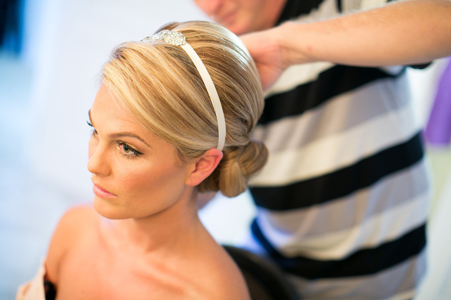 Bride during hair and makeup