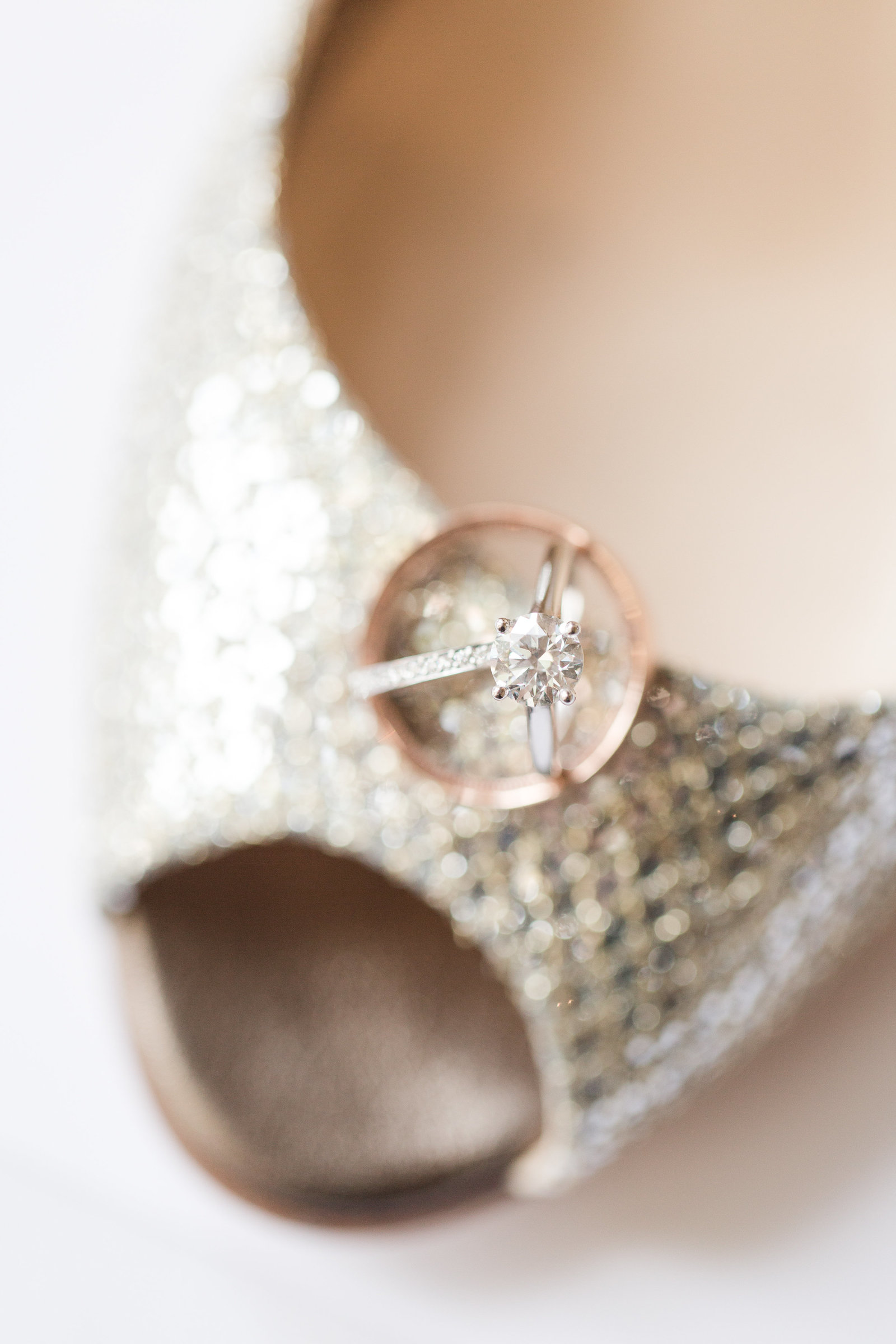 jimmy choo and diamond engagement ring and rose gold wedding band