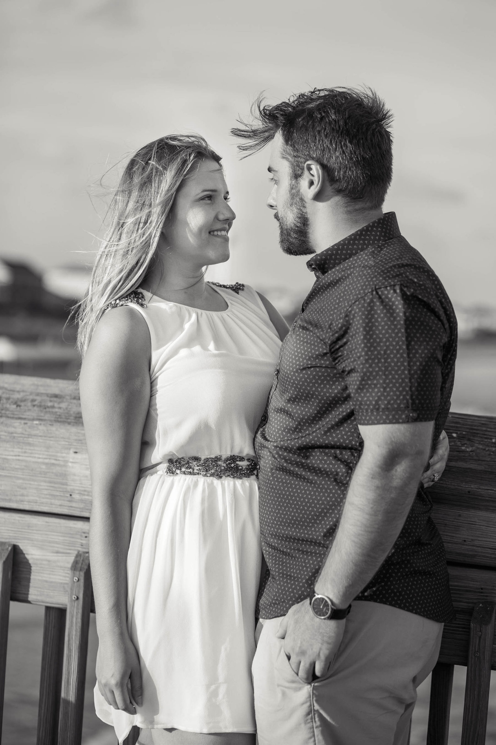 Engaged Couple walk down pier, Folly beach in Charleston, South Carolina