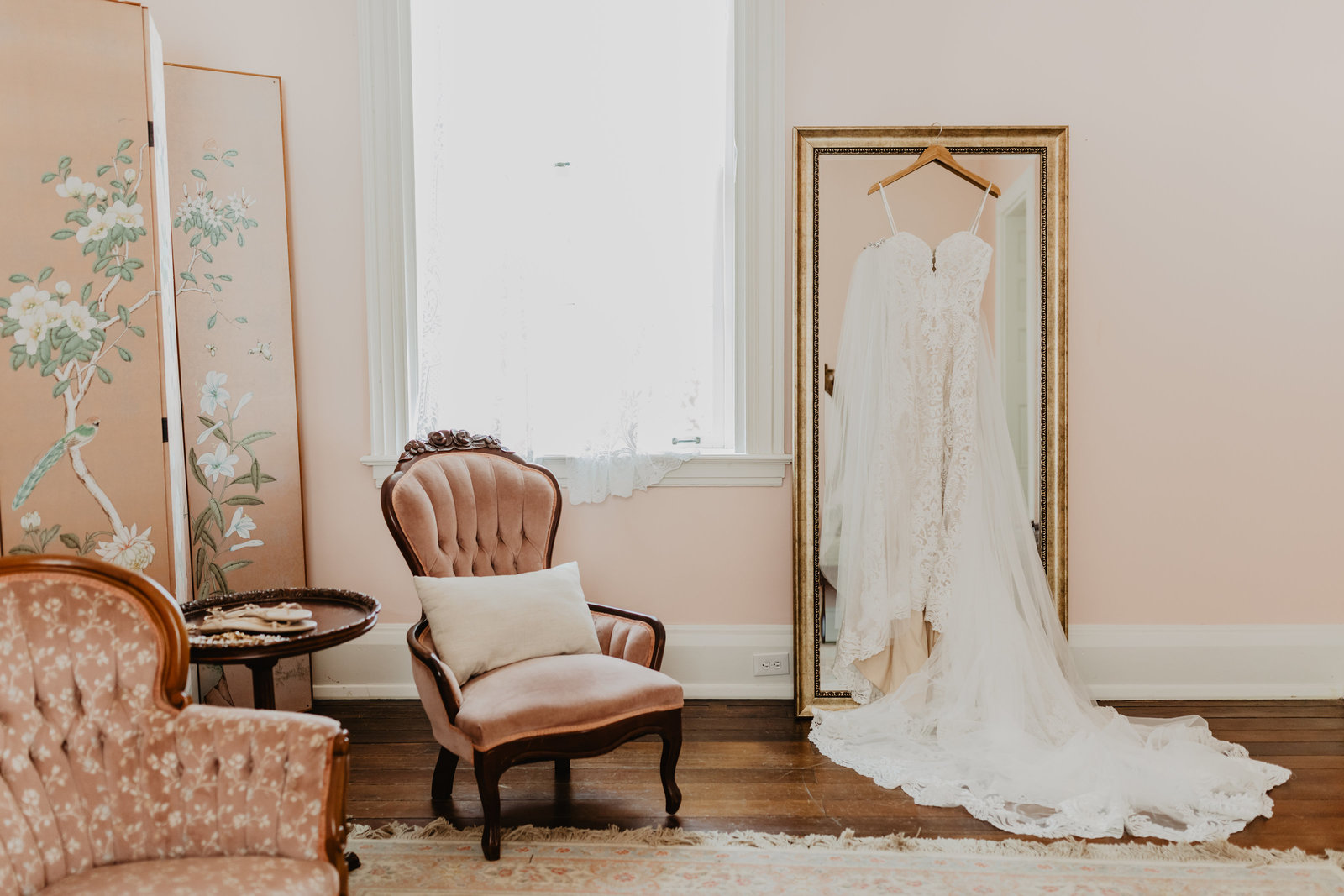 Wedding dress hanging in bridal suite at Ravenswood Manson.