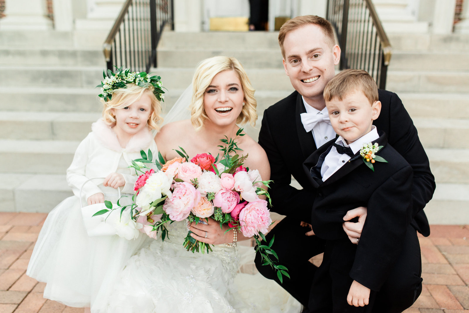 bride and groom with their flower girl and ring bearer