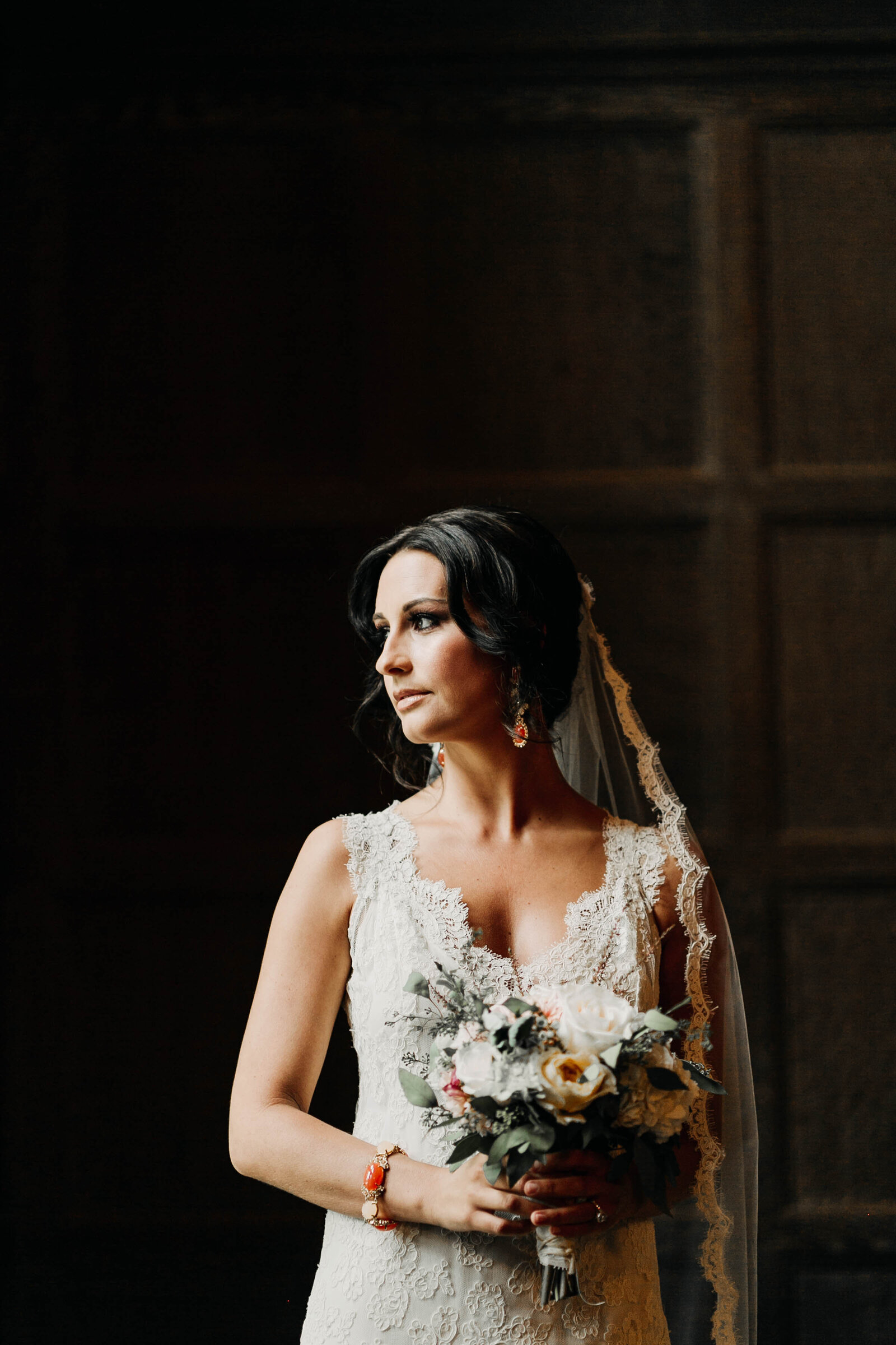 bride with lace dress at window light
