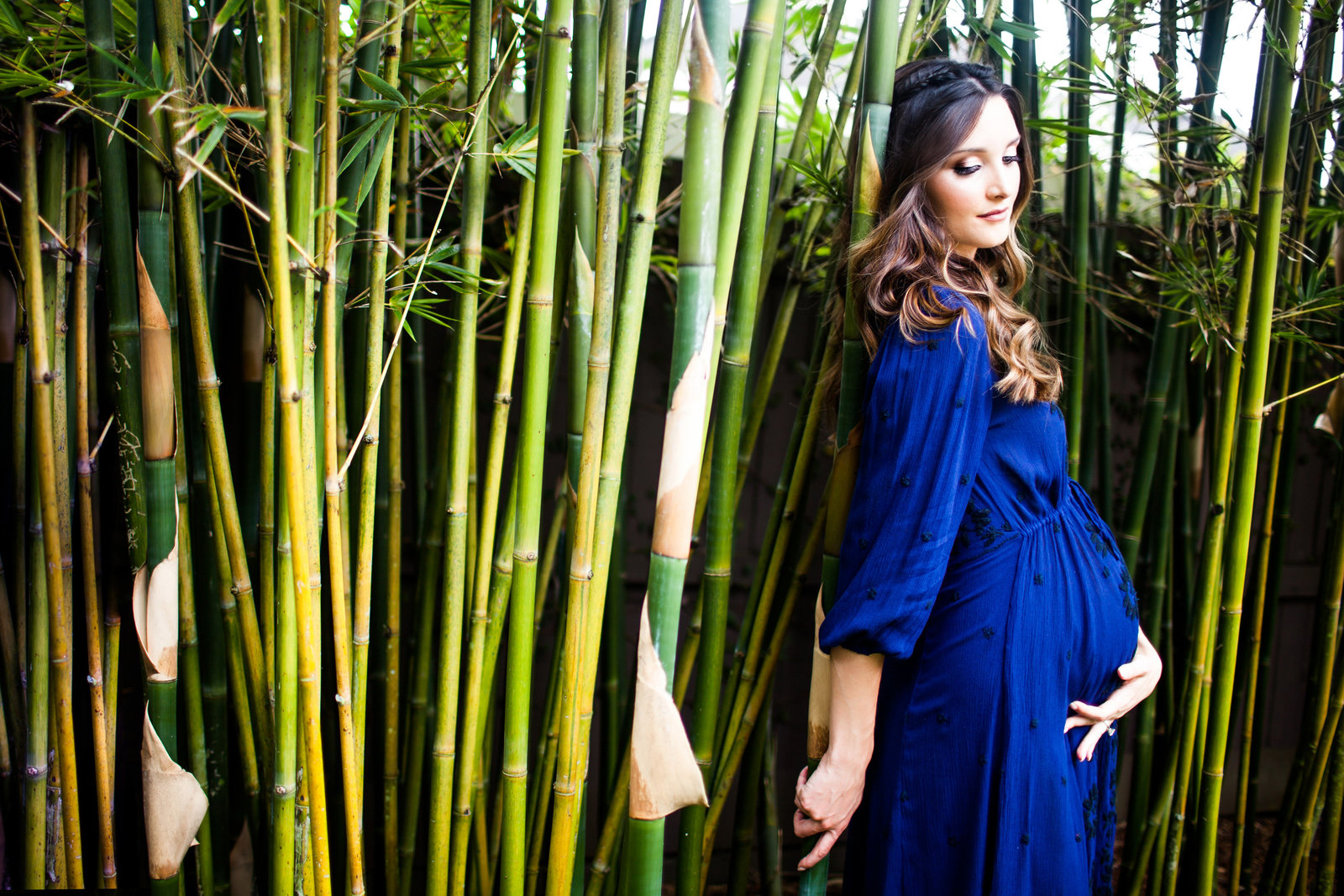 Maternity pictures in front of bamboo