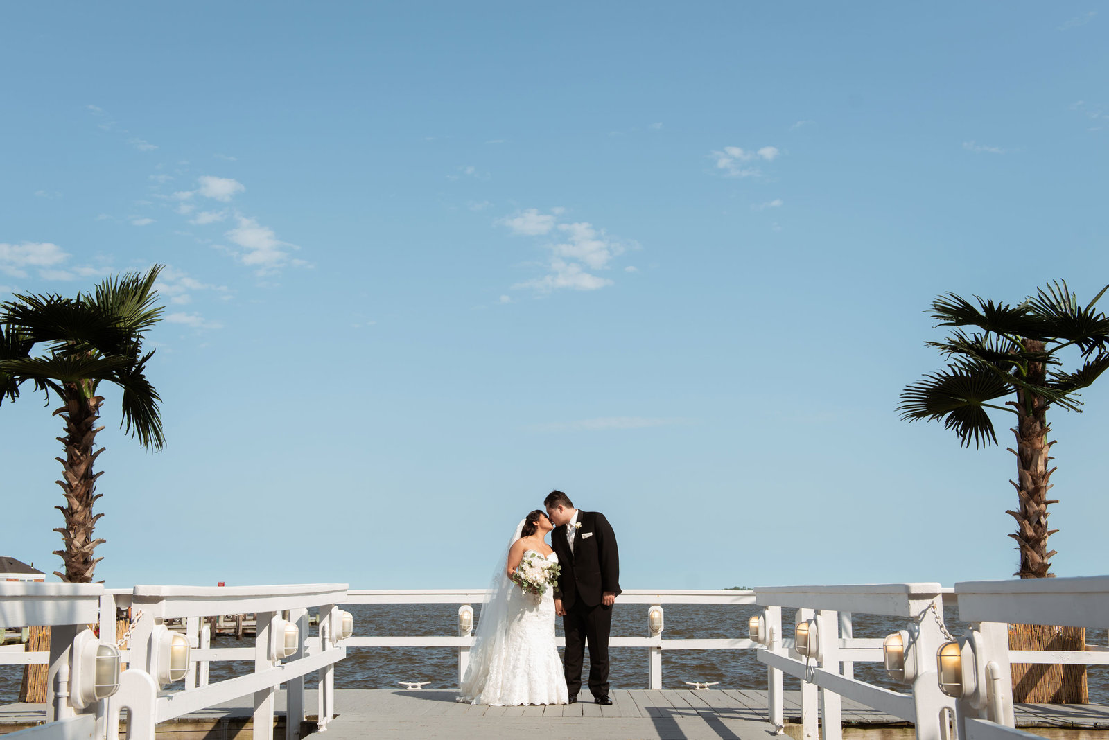Bride and groom on dock at Chateau La Mer