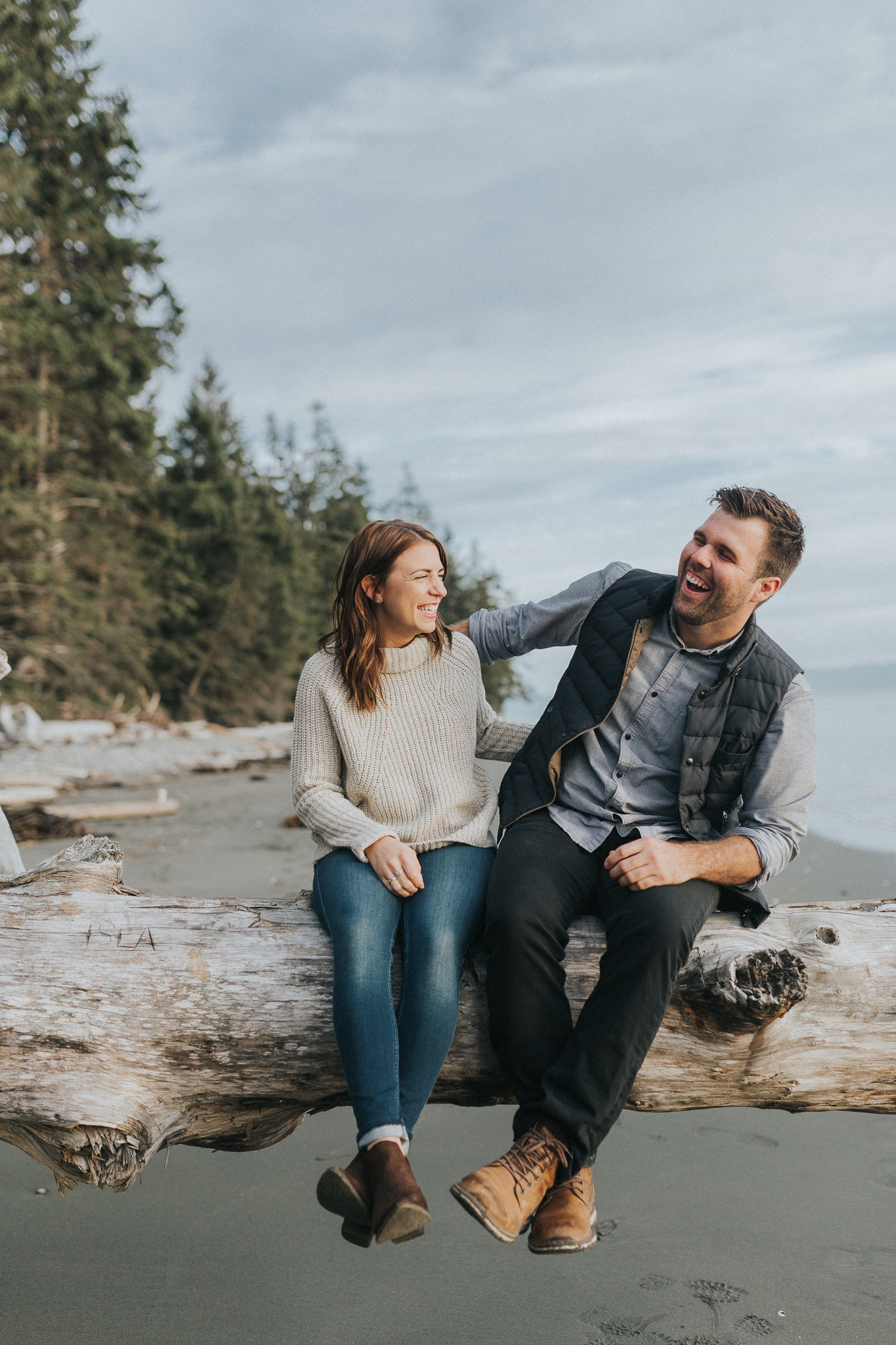 Engaged couple having a laugh at China Beach