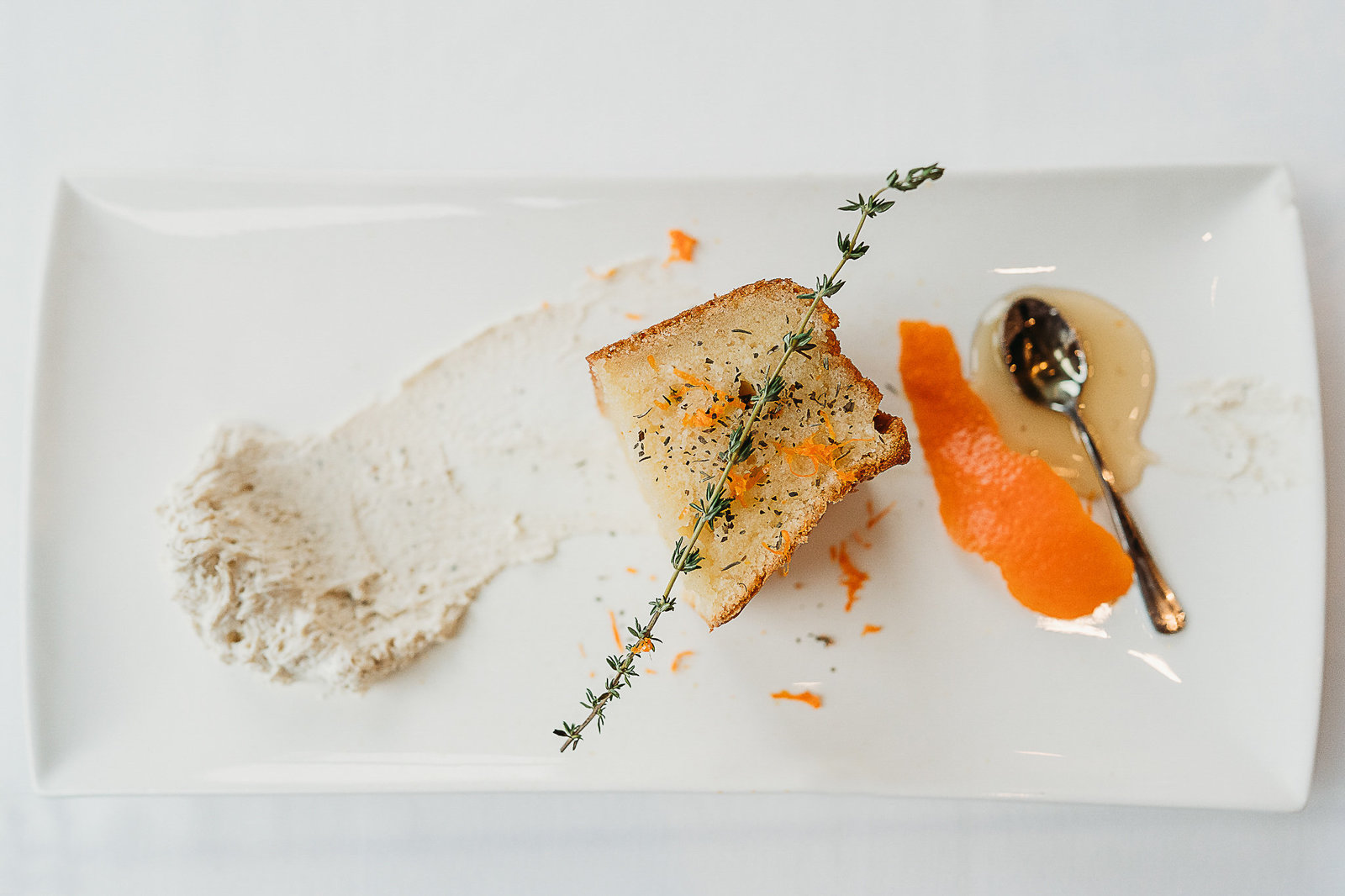 overhead shot of a dessert with orange peels on a white plate